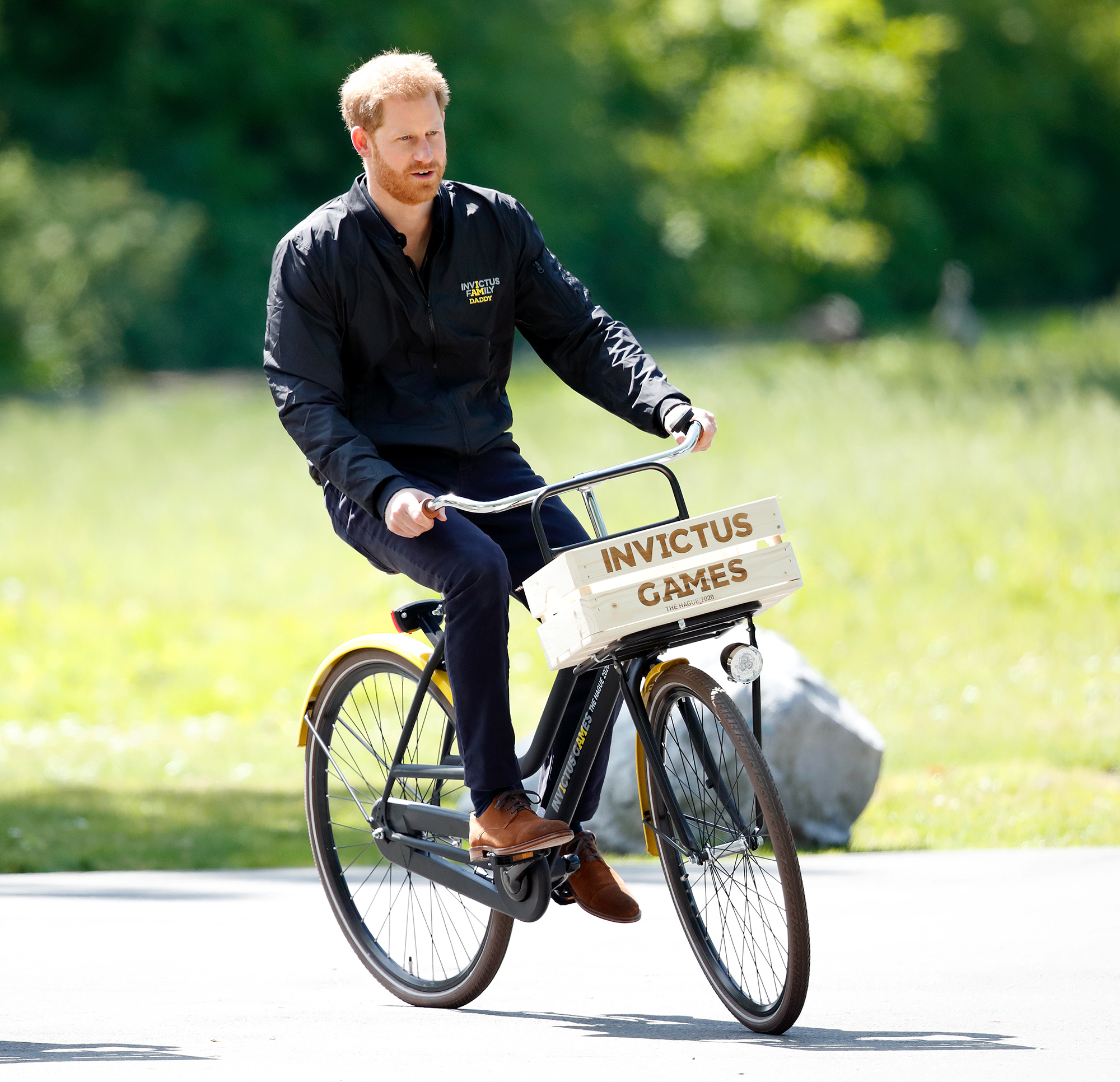 Prince Harry Bike - Prince Harry, Duke of Sussex rides a bicycle around Sportcampus Zuiderpark as part of a programme of events to mark the official launch of the Invictus Games The Hague 2020 on May 9, 2019 in The Hague, Netherlands.