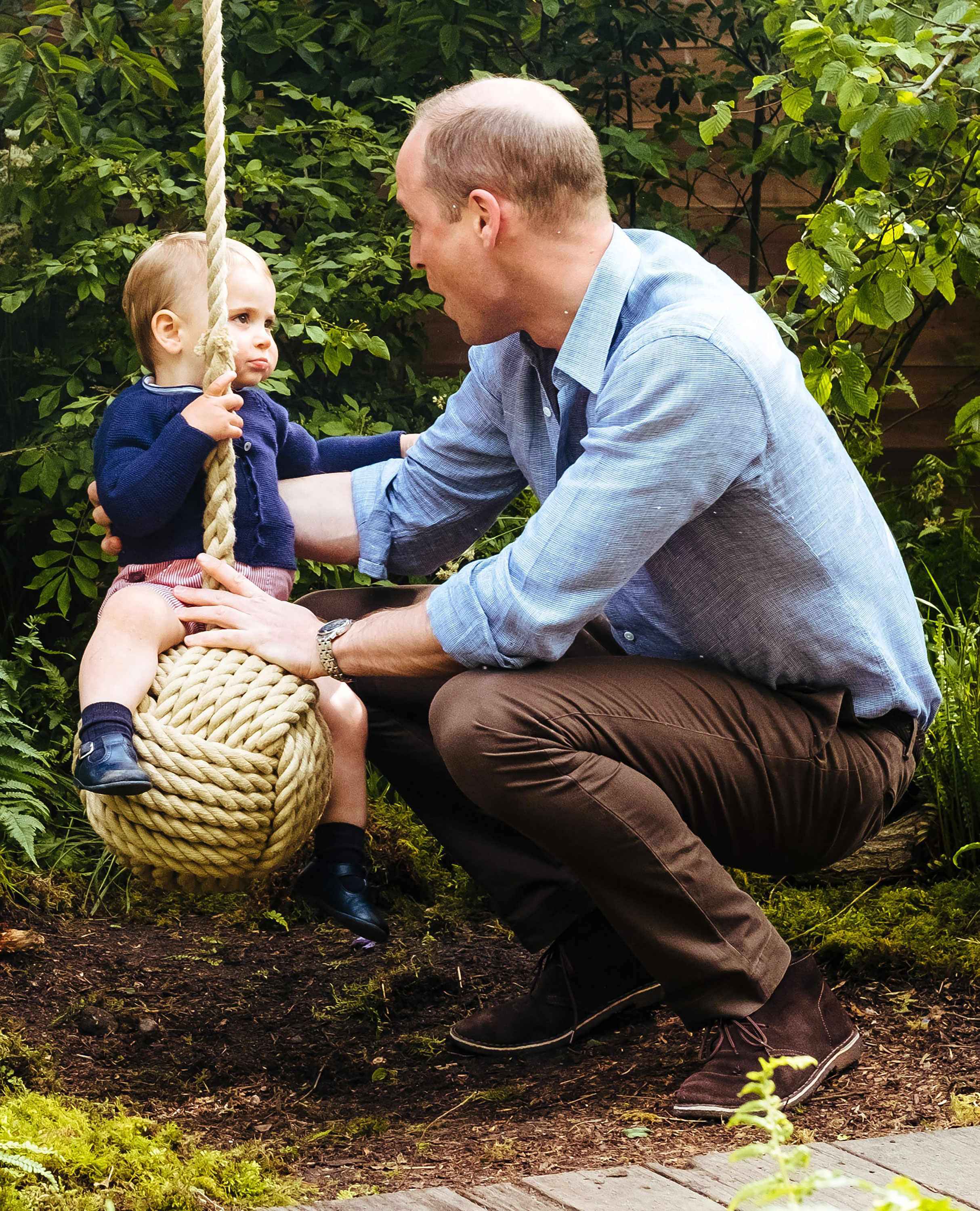 Prince William, Duchess Kate and Kids Play in the Garden She Designed at Chelsea Flower Show - William pulled a funny face as Louis focused on his father.