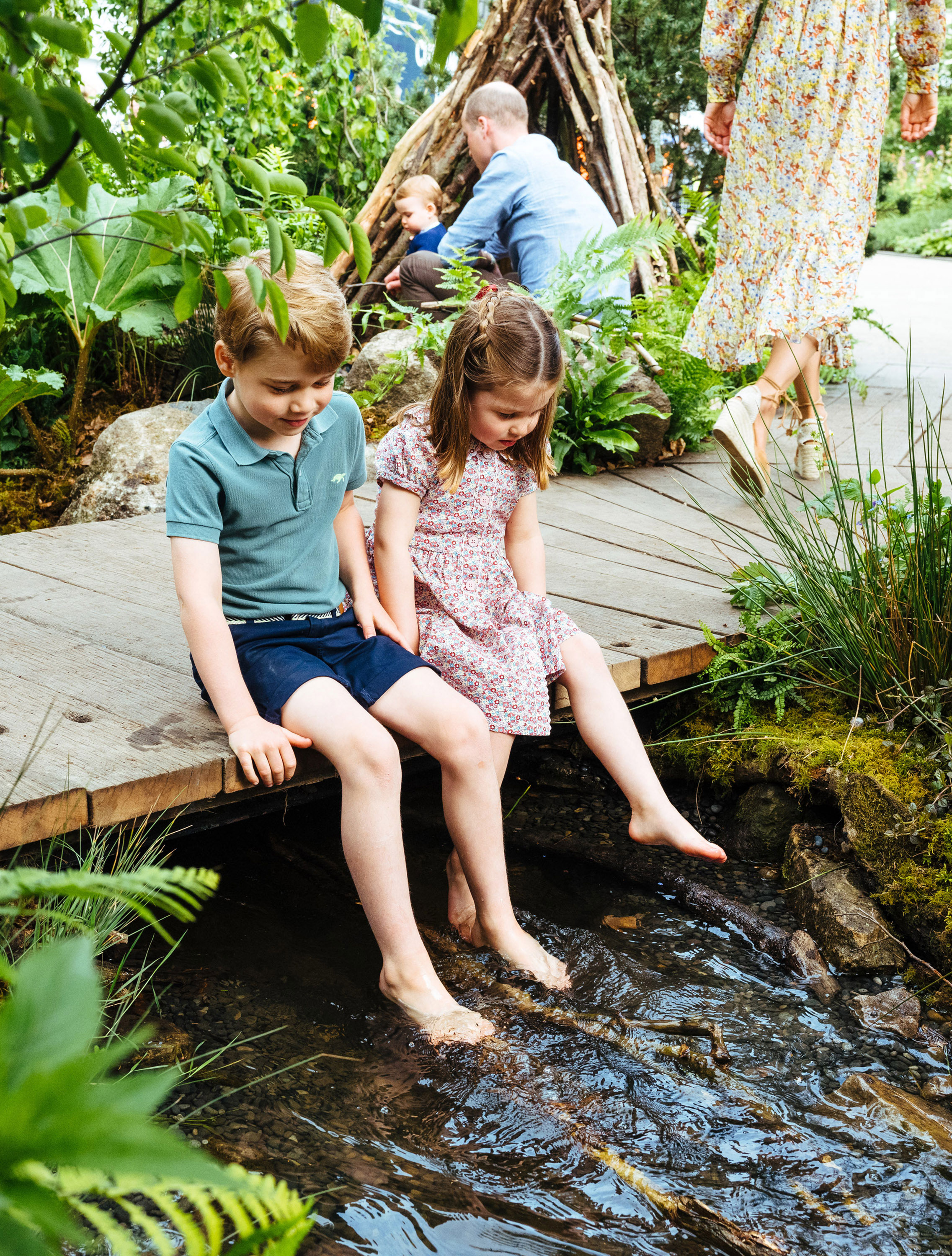 Prince William, Duchess Kate and Kids Play in the Garden She Designed at Chelsea Flower Show - George and Charlotte took off their shoes and dangled their feet in the stream.