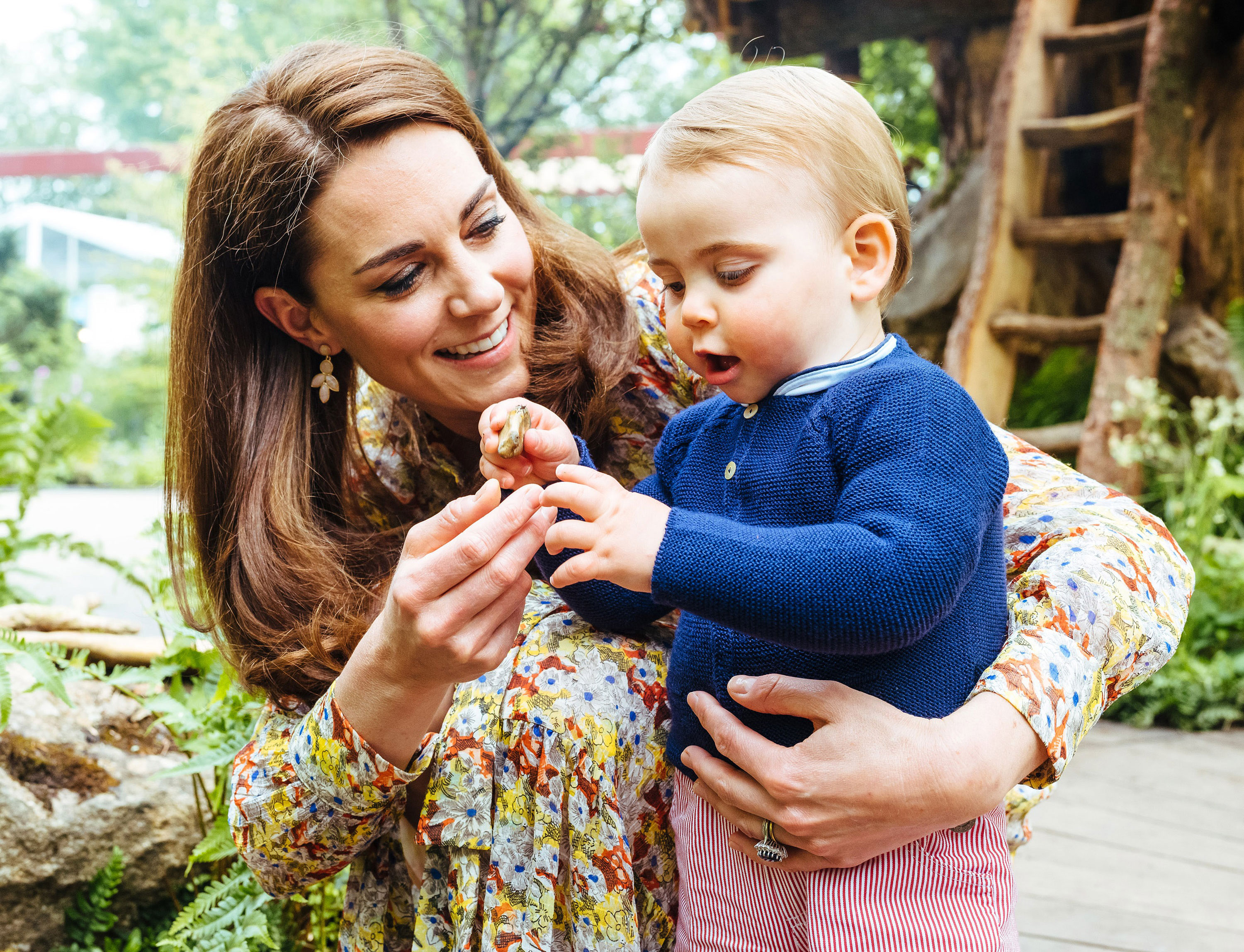 Prince William, Duchess Kate and Kids Play in the Garden She Designed at Chelsea Flower Show - Kate paid tribute to William's late mother, Princess Diana, by including her favorite flowers, forget-me-nots, in the garden's design.