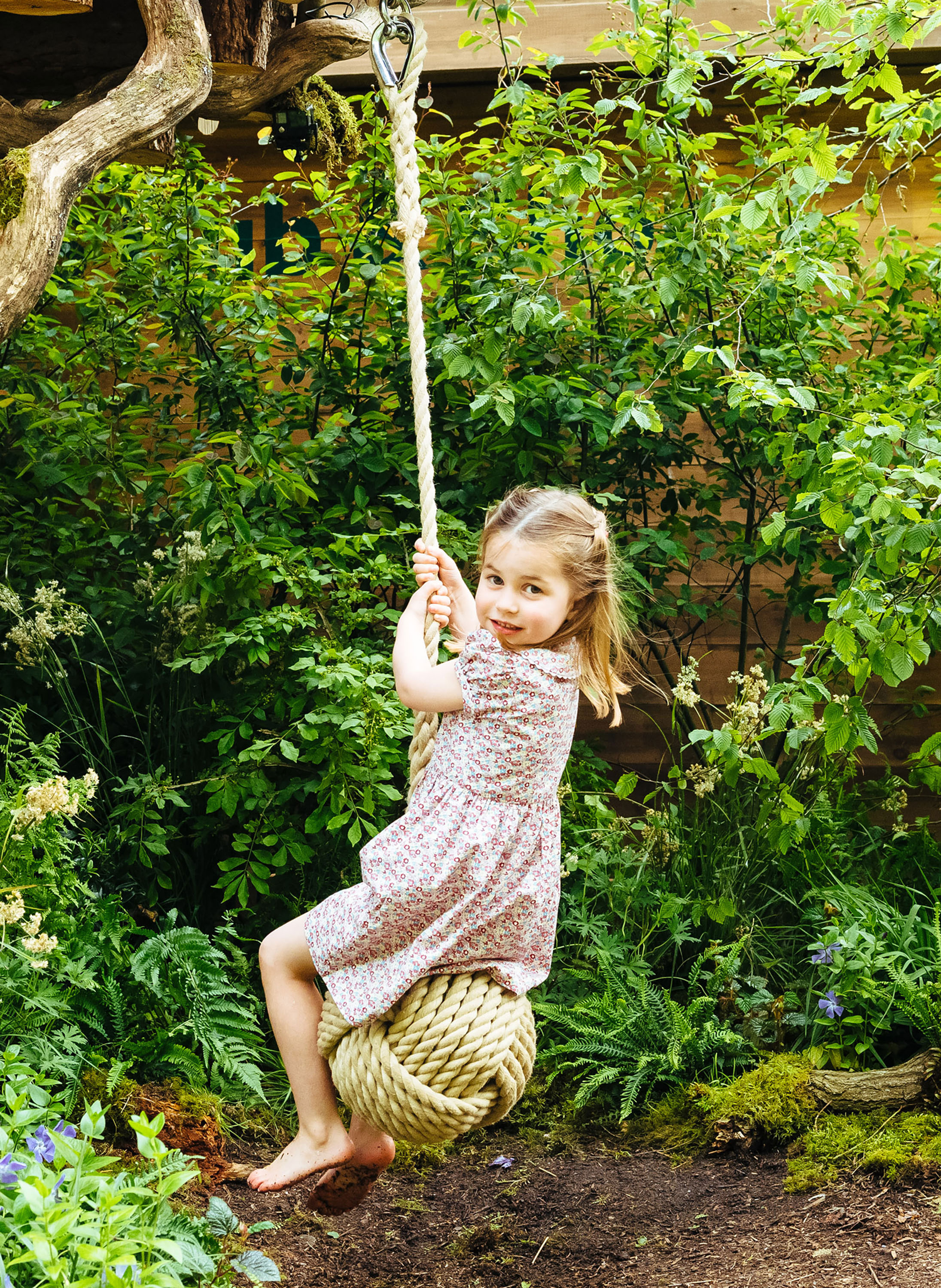 Prince William, Duchess Kate and Kids Play in the Garden She Designed at Chelsea Flower Show - Charlotte channeled her inner Miley Cyrus in a pose similar to one her mom took in photos released on Saturday.