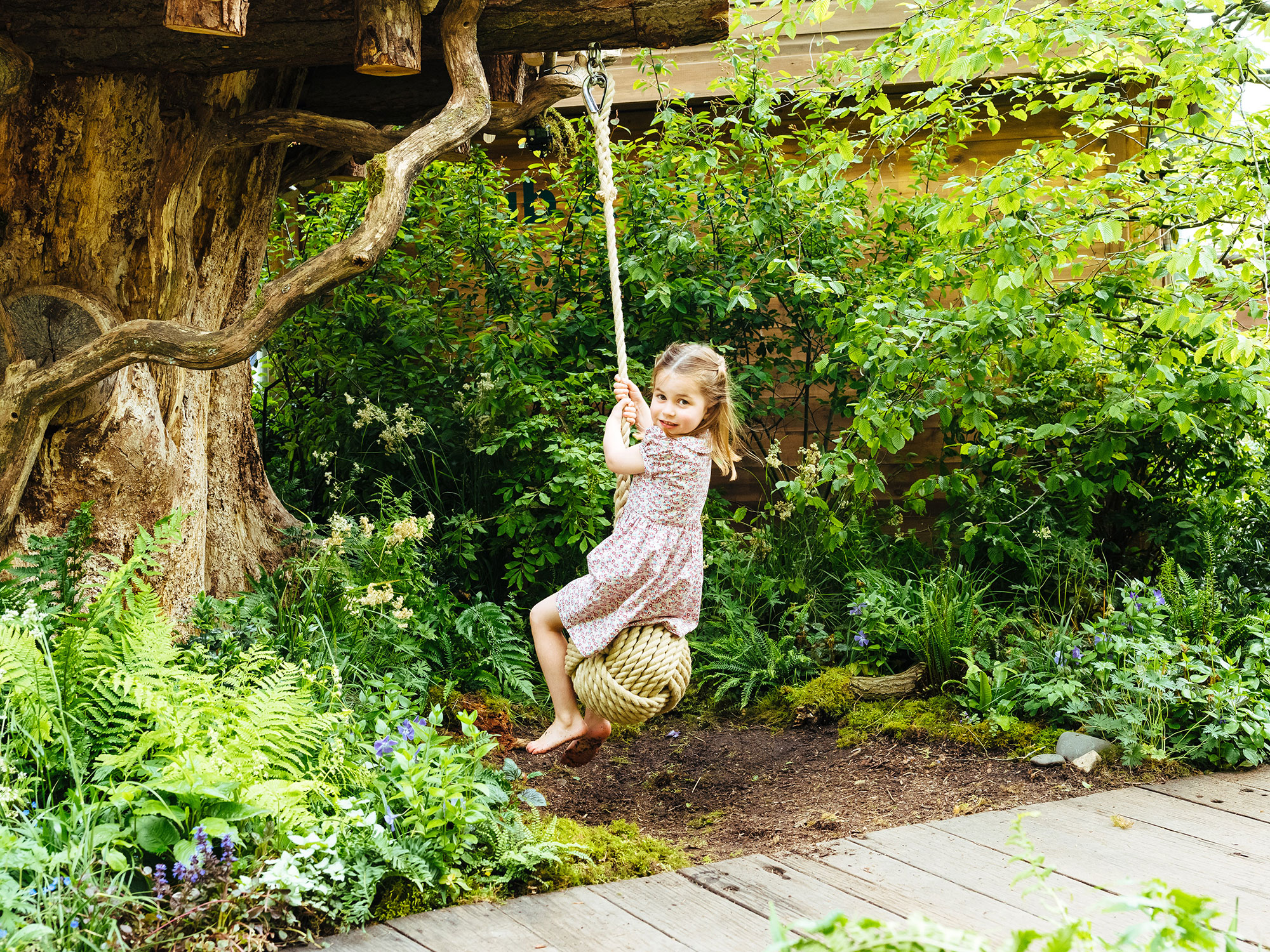 Prince William Princess Charlotte Nickname - Princess Charlotte swings from a tree in the Adam White and Andree Davies co-designed garden ahead of the RHS Chelsea Flower Show in London on May 19, 2019.