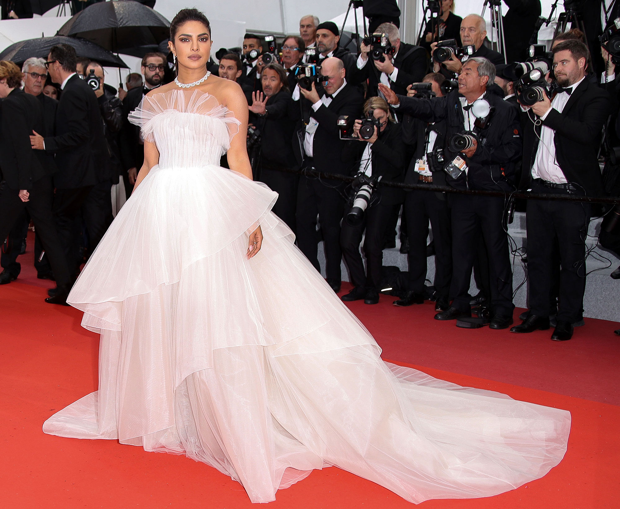 Stepping Out in Style at Cannes Film Festival - After walking the carpet with hubby Nick Jonas, the actress posed in her voluminous Georges Hobeika gown and Chopard bling at the Les Plus Belles Annees D'Une Vie premiere on Saturday, May 18.