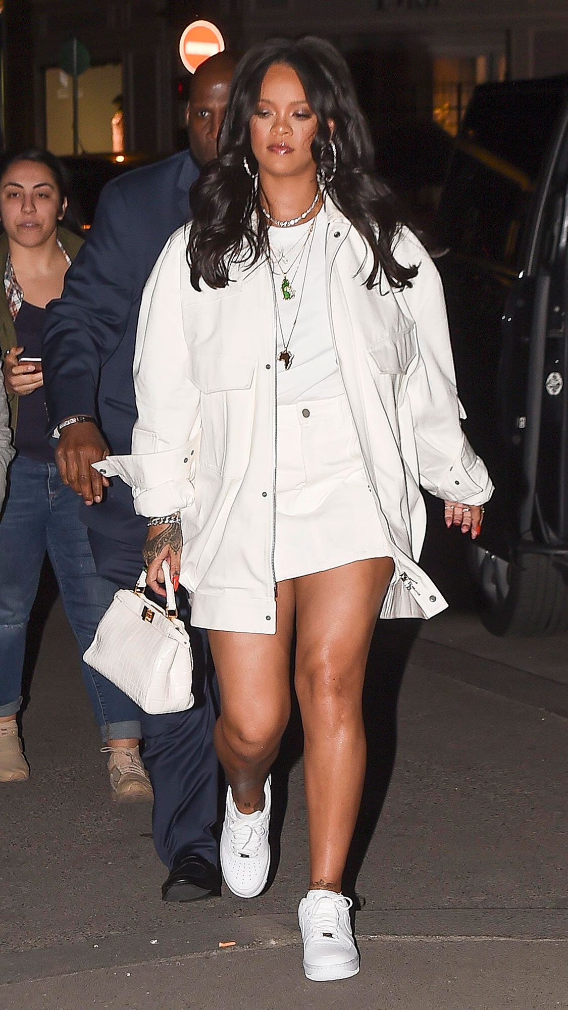 Rihanna Memorial Day White - When leaving her Fenty fashion launch on May 22, 2019, the founder accessorized her white minidress with a matching bomber, purse and sneakers.