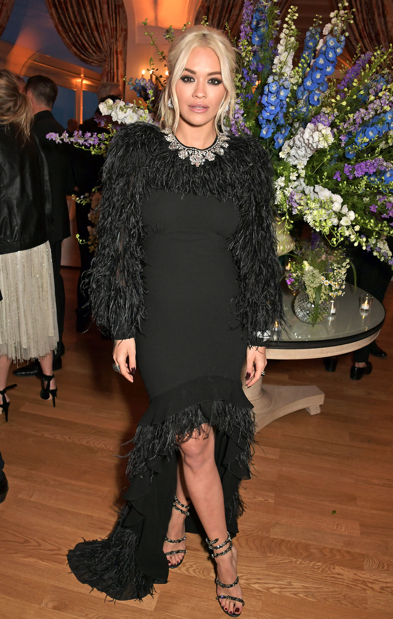 Rita Ora Stepping Out in Style at Cannes Film Festival - Black was anything but boring for the songstress in a feathery Michael Kors gown and embellished Rene Caovilla sandals at the Filmmakers Dinner on Friday, May 17.