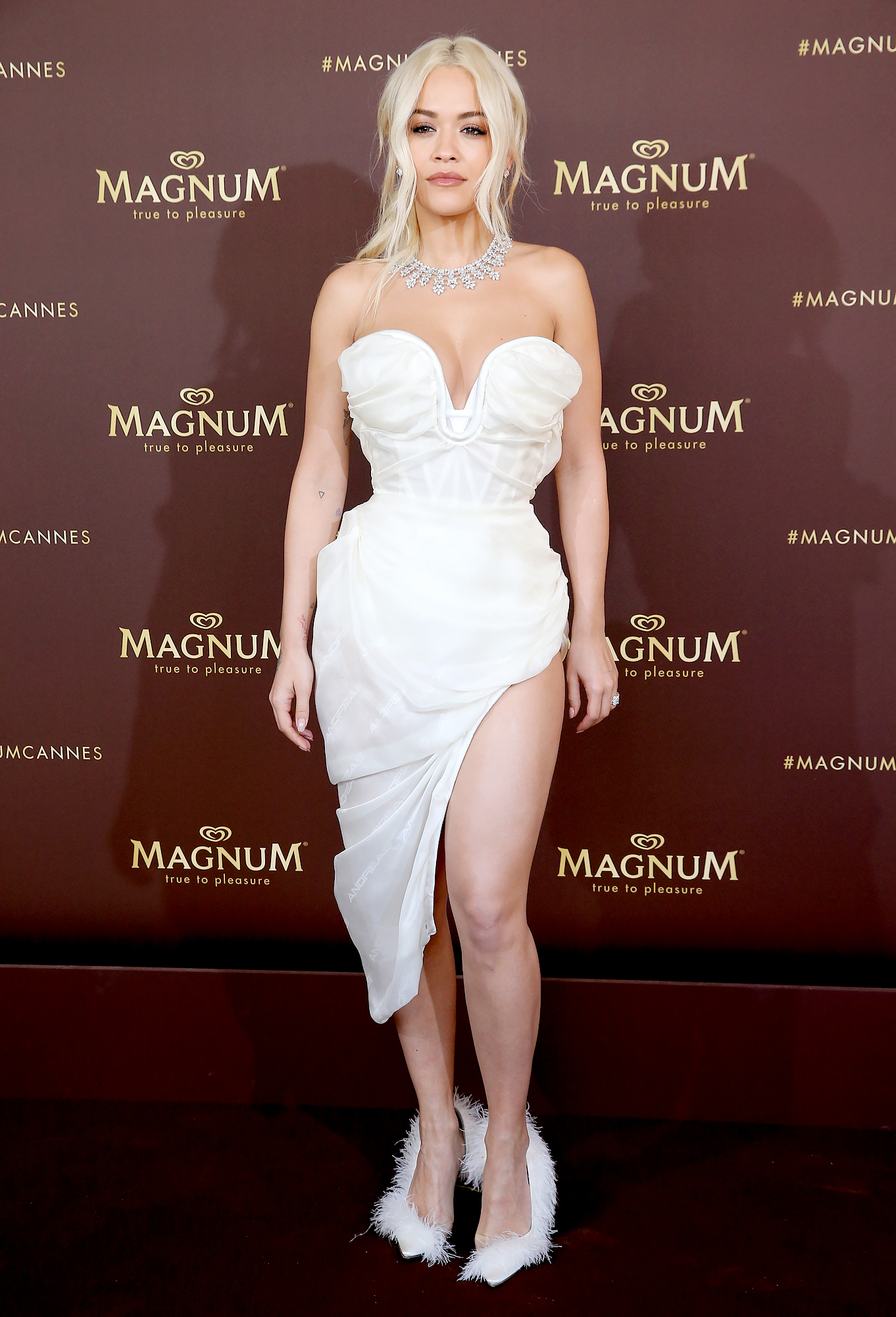 Rita-Ora-Cannes-Festival - The only thing hotter than the songstress' bustier-inspired minidress at the RAGNUM x Rita Ora event on Thursday, May 16? Her feathery pumps.