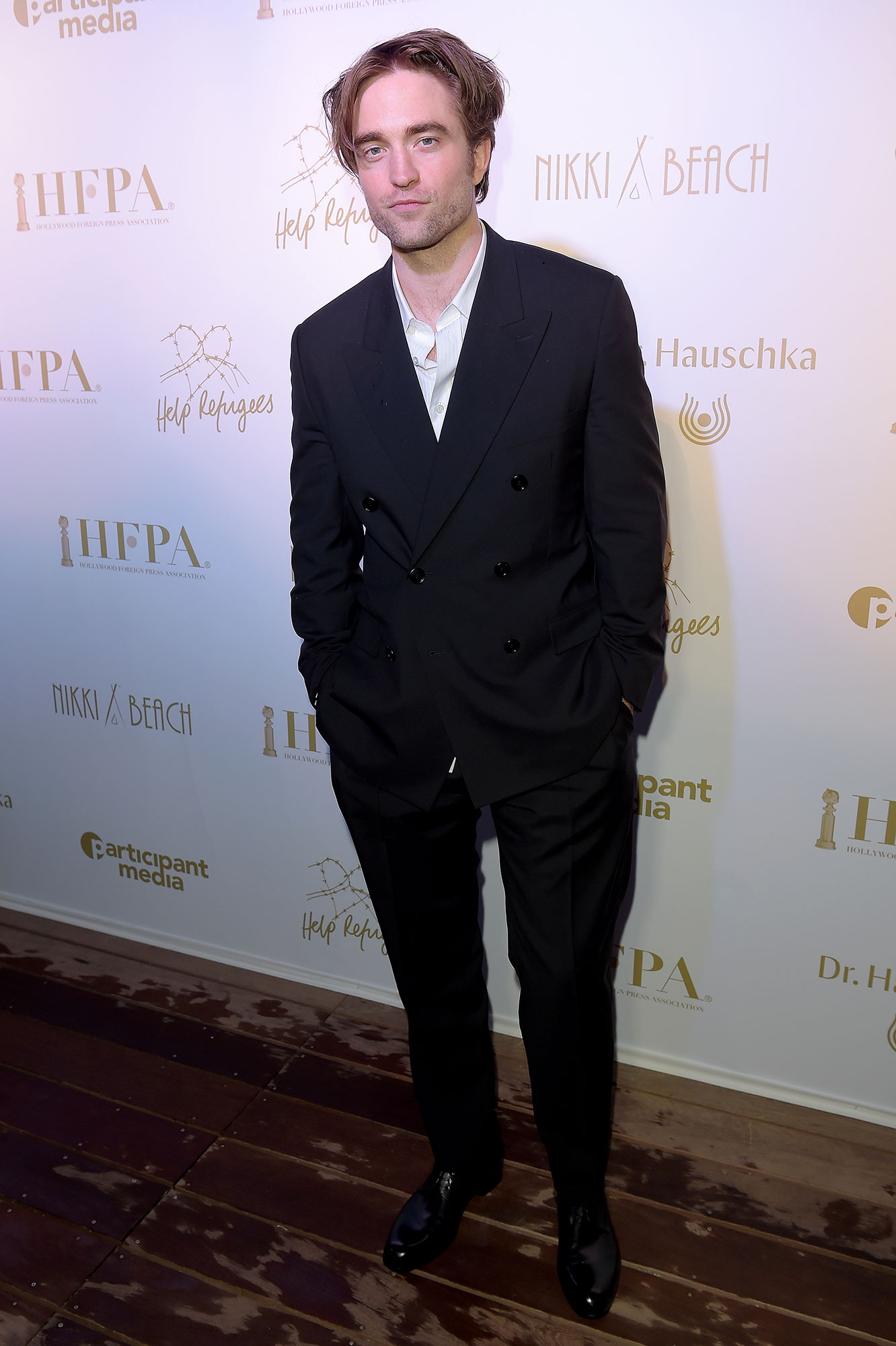 Robert Pattinson Cannes Film Festival 2019 Most Stylish Guys Red Carpet - The former Twilight star dressed down his double-breasted suit by skipping a tie at the HFPA & Participant Media Honour Help Refugees event on Sunday, May 19.