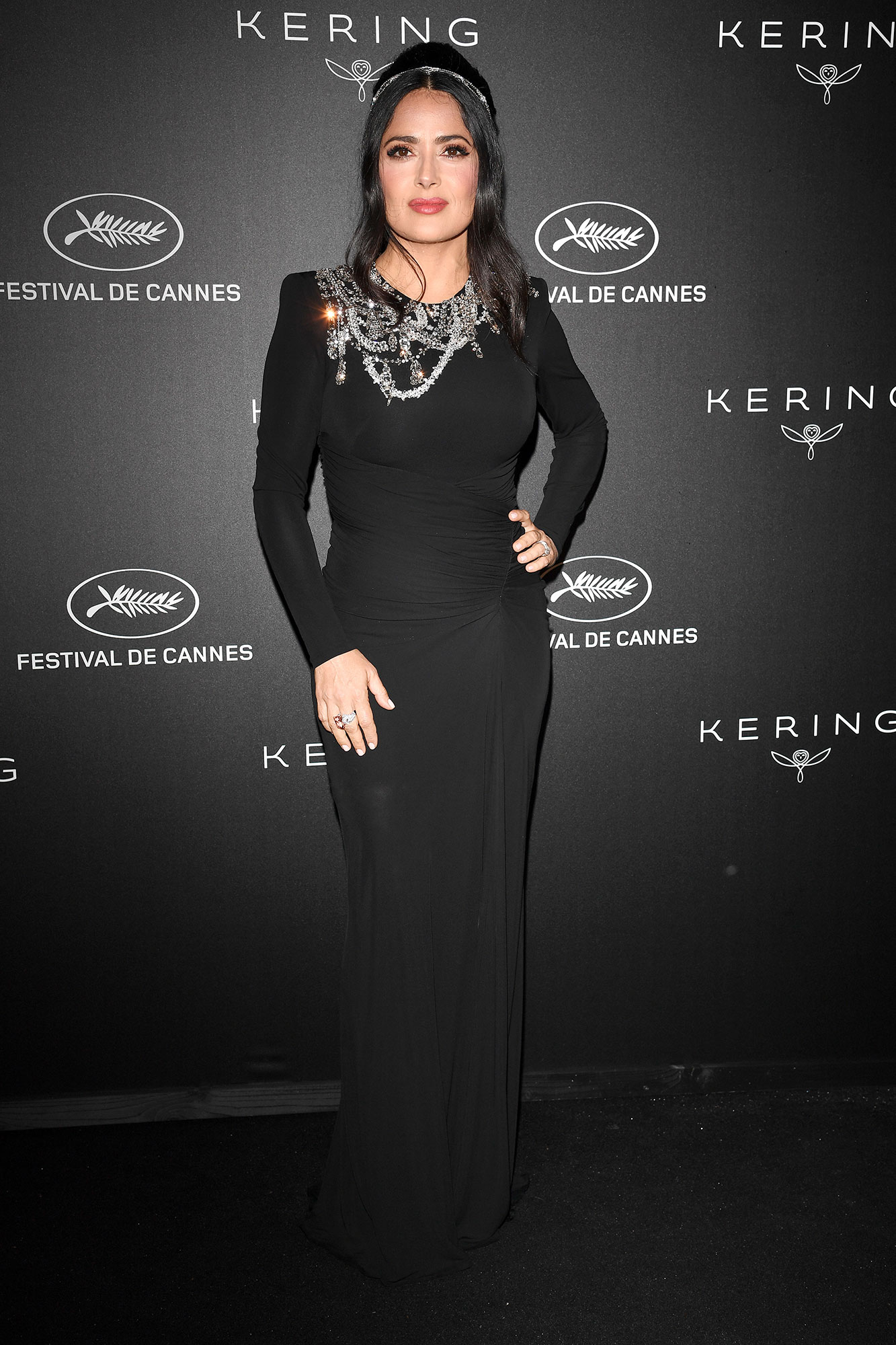 Stepping Out in Style at Cannes Film Festival - A crystal-embellished neckline gave the actress' curve-hugging LBD a sparkly spin at the Kering dinner on Sunday, May 19.