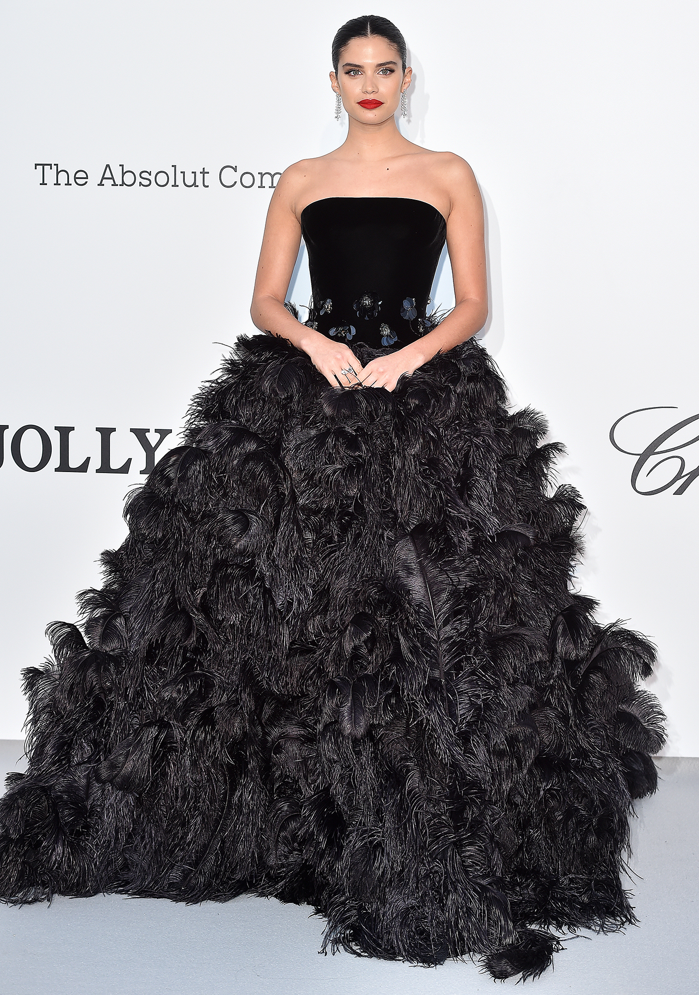 Sara-Sampaio - Proving black is anything but boring, the model rocked a feathery Armani ballgown at the amfAR Cannes Gala on Thursday, May 23.