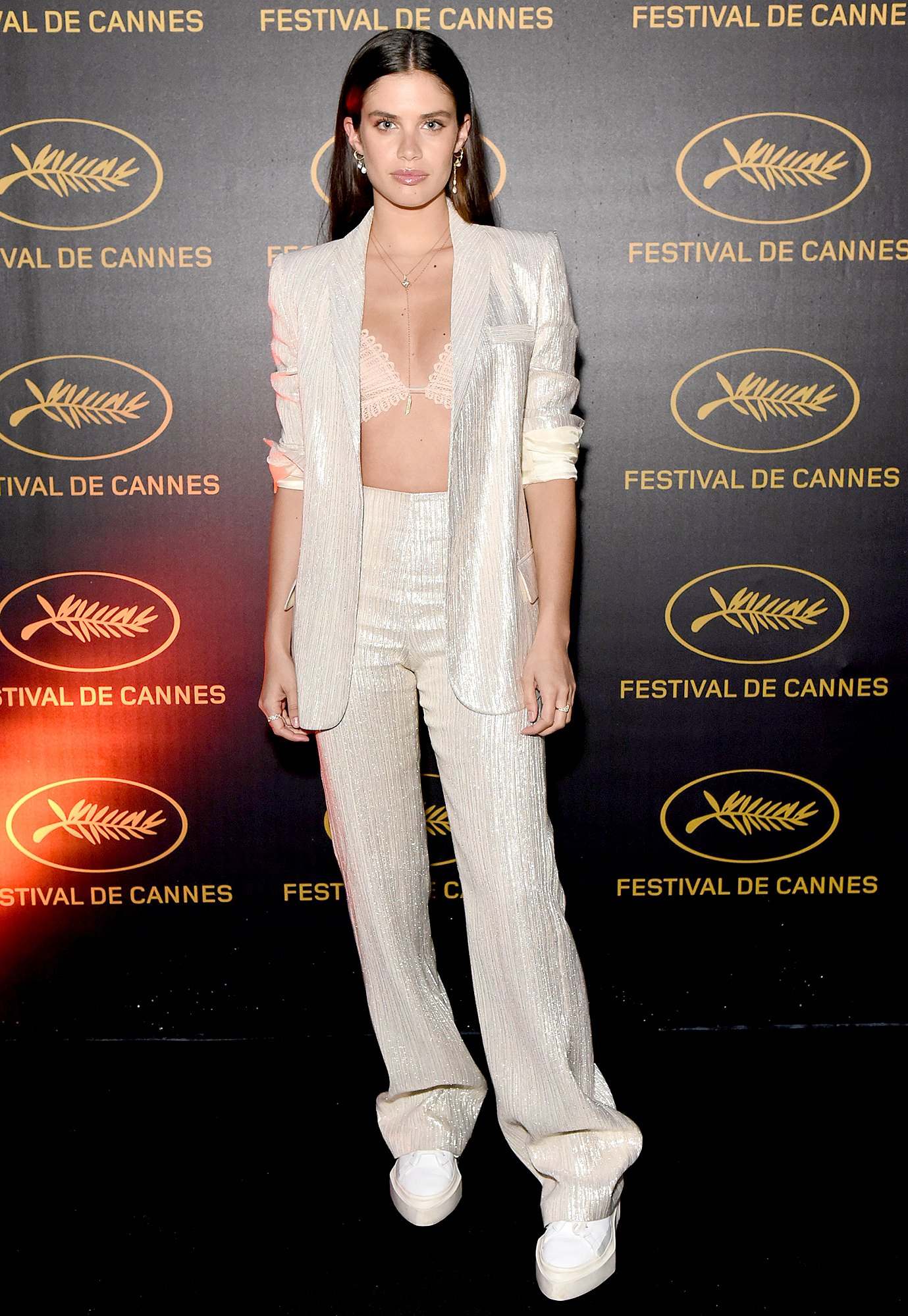 Sara-Sampaio - A lacy bra and chunky white kicks were cool-girl additions to the model's shimmering shirtless pantsuit at a party on Monday, May 20.