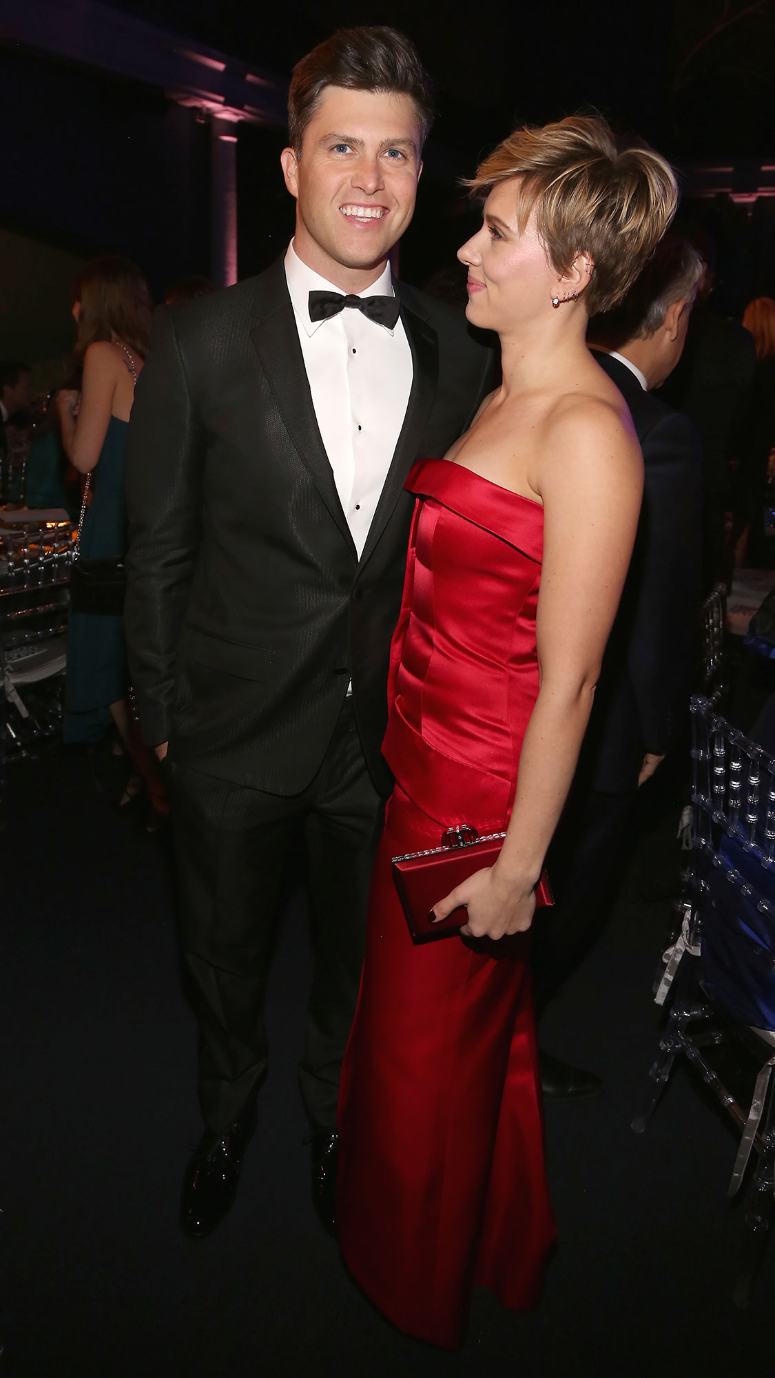 Scarlett Johansson and Colin Jost Relationship Timeline American Museum of Natural History - Johansson and Jost posed together at the American Museum of Natural History Gala, where she wore a red dress and he looked sharp in a black tuxedo.