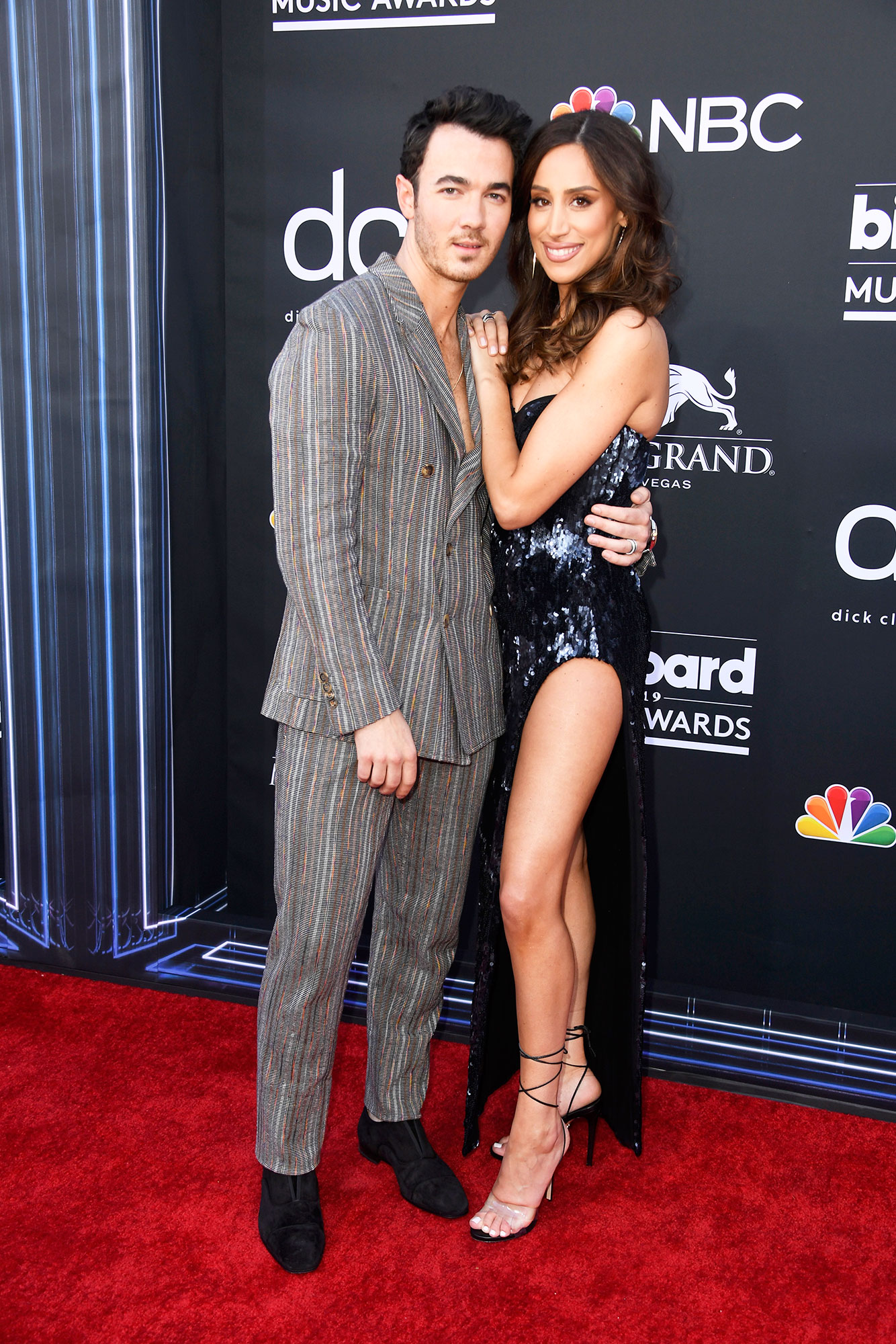 See the Hottest Couples at the BBMAs Kevin Jonas of Jonas Brothers ans Danielle Jonas - The oldest JoBro looked handsome in a striped suit and his wife shimmered in a sequined gown with a thigh-high slit.