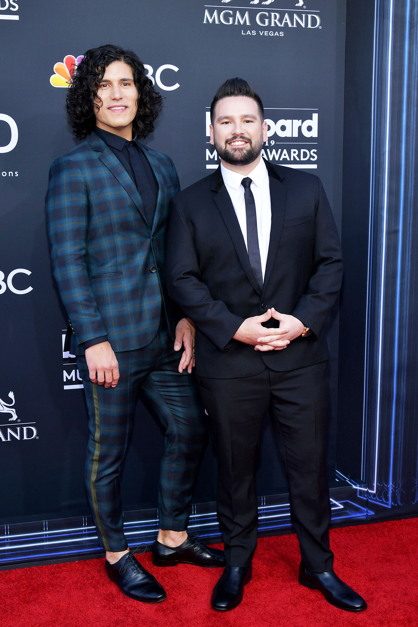 See the Hottest Couples at the BBMAs Dan Reynolds and Shay Mooney of Dan + Shay - The Dan + Shay duo showed off their suit style in plaid and black respectively.