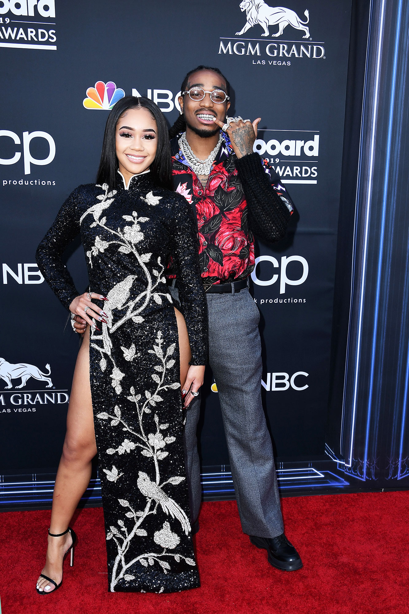 See the Hottest Couples at the BBMAs Saweetie with Quavo of Migos - It was all about the sparkle for the glitzy duo, who coordinated in shimmering floral prints.