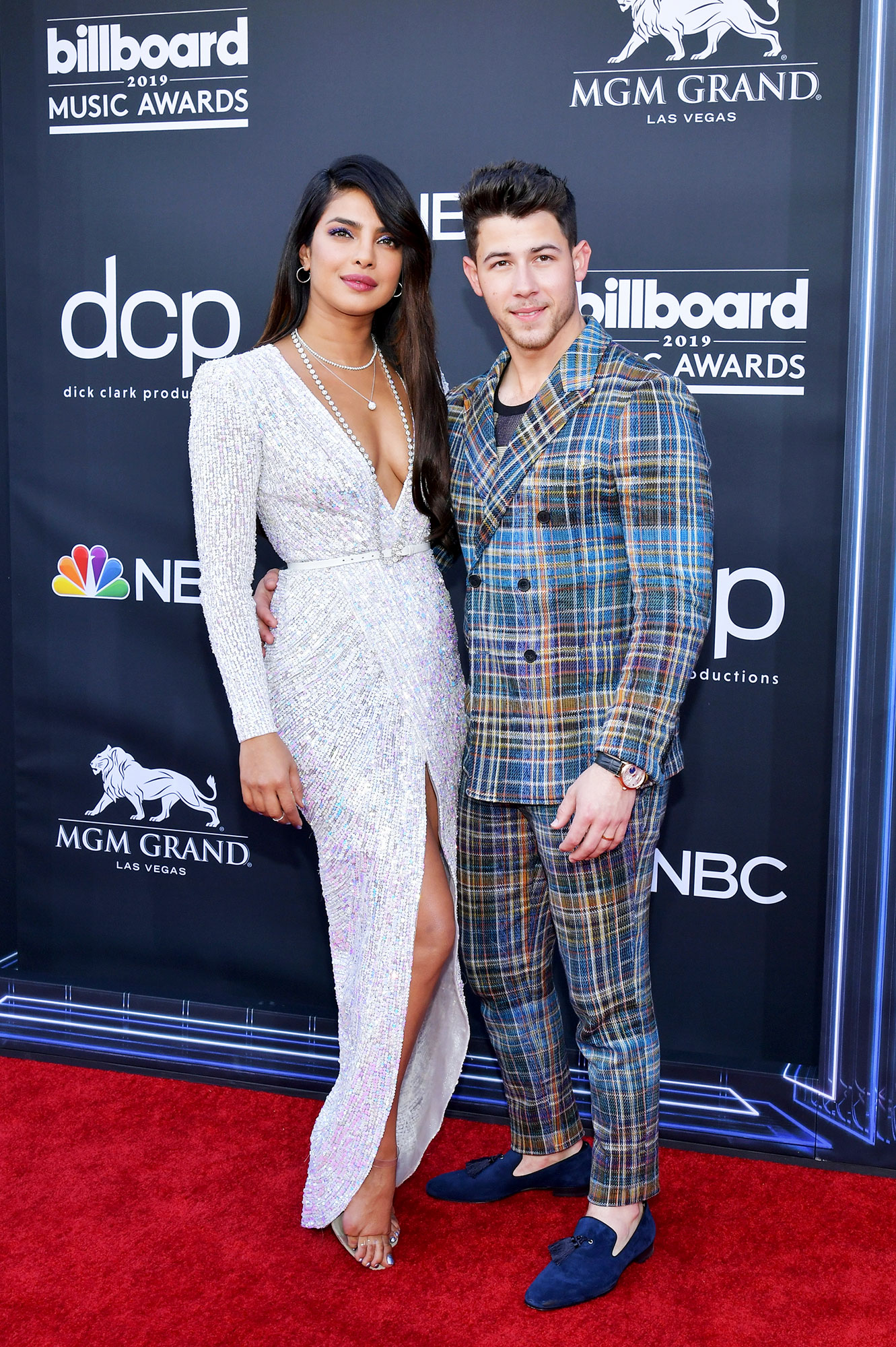 See the Hottest Couples at the BBMAs Priyanka Chopra and Nick Jonas - The former Quantico actress stunned in a plunging Zuhair Murad gown and Tiffany & Co. diamonds, while her hubby played with prints in a double-breasted plaid suit.