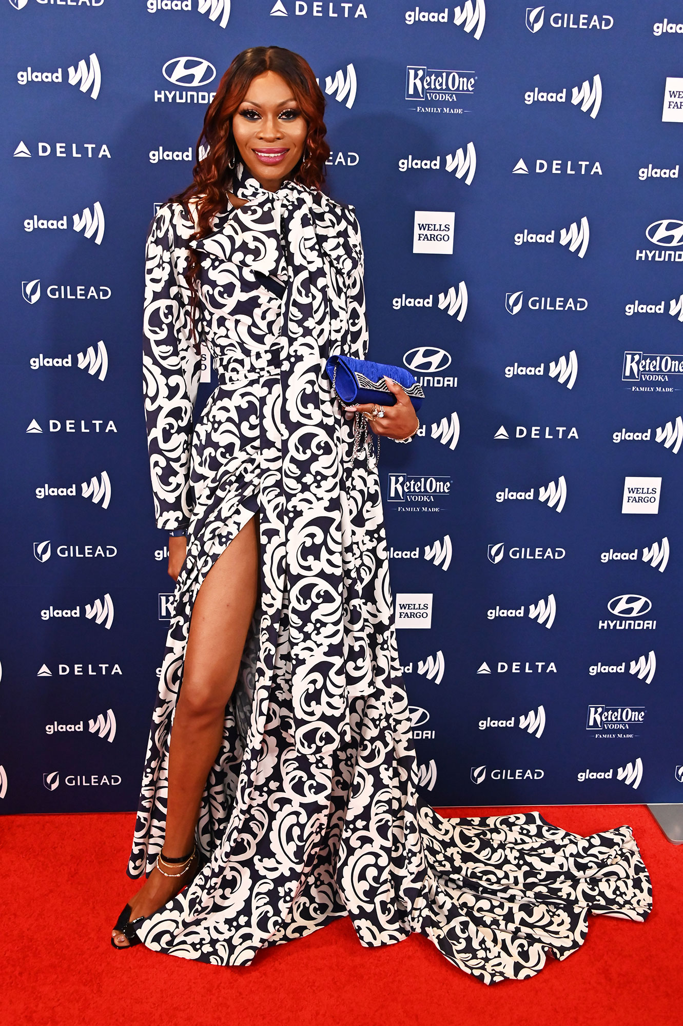 See the Stars at the GLAAD Awards Dominique Jackson - Wearing a black and white printed Adrian Alicea gown with Christian Louboutin heels.