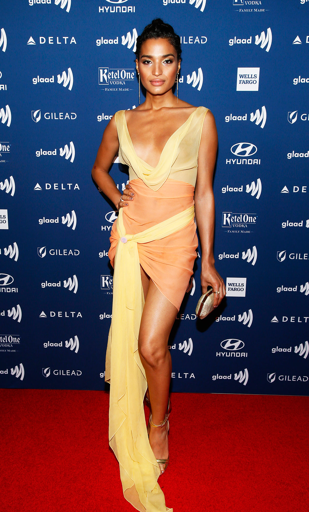 See the Stars at the GLAAD Awards Indya Moore - Wearing a nearly naked Calvin Klein minidress and Tyler Ellis clutch.