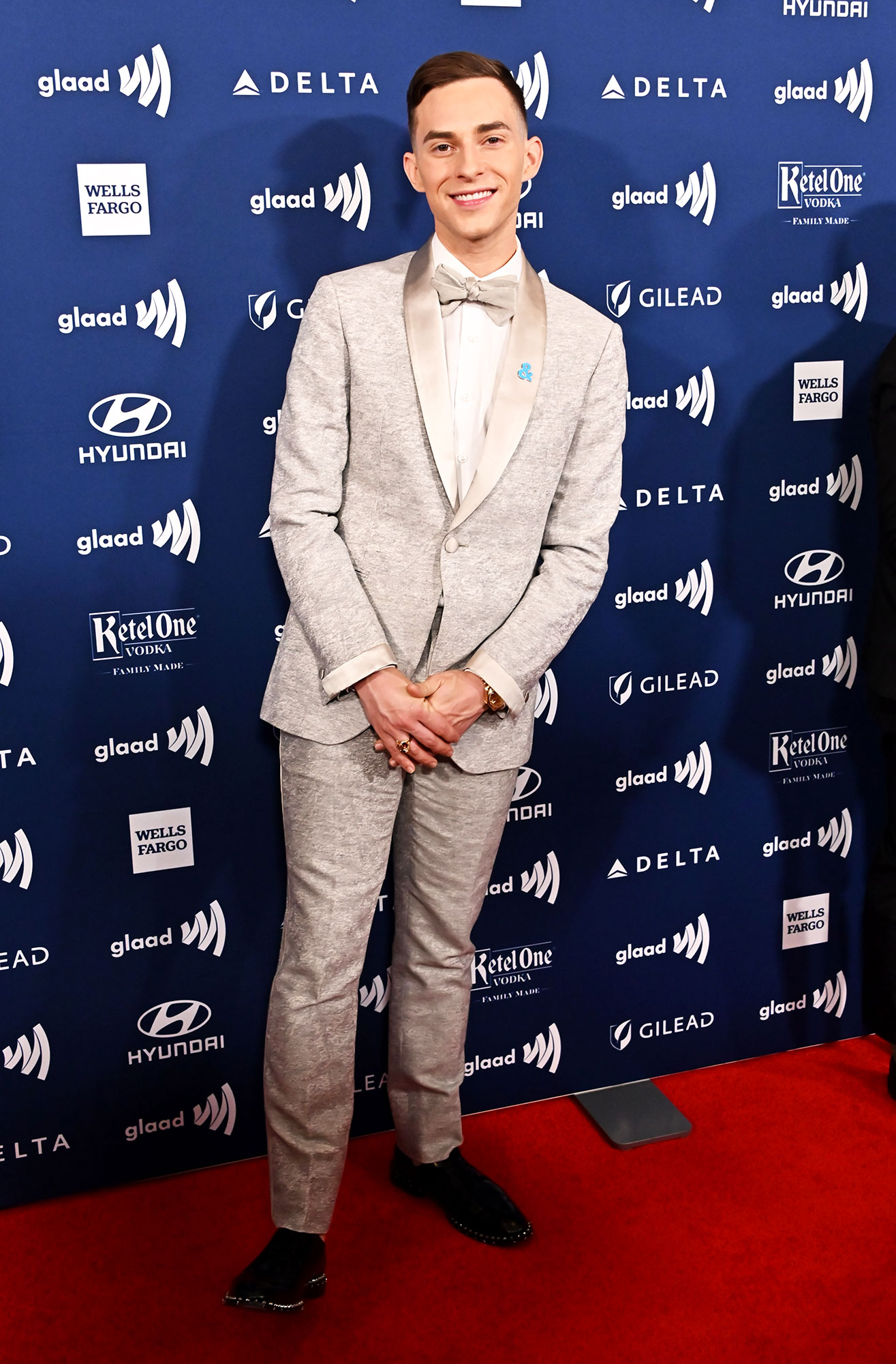 See the Stars at the GLAAD Awards - Wearing a heather grey tux with silver lapels.