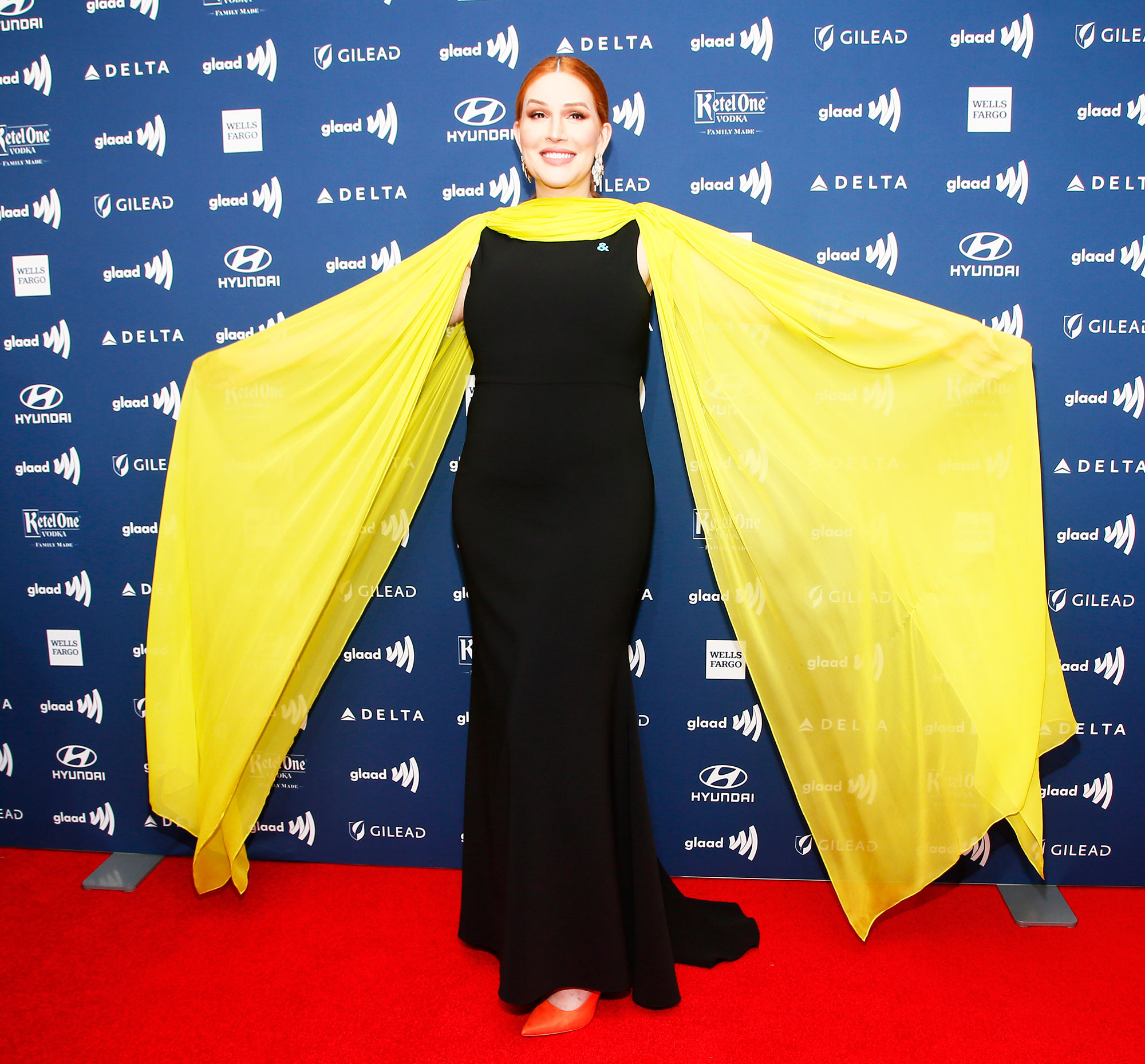 See the Stars at the GLAAD Awards Our Lady J - Wearing a black and yellow Christian Siriano gown.