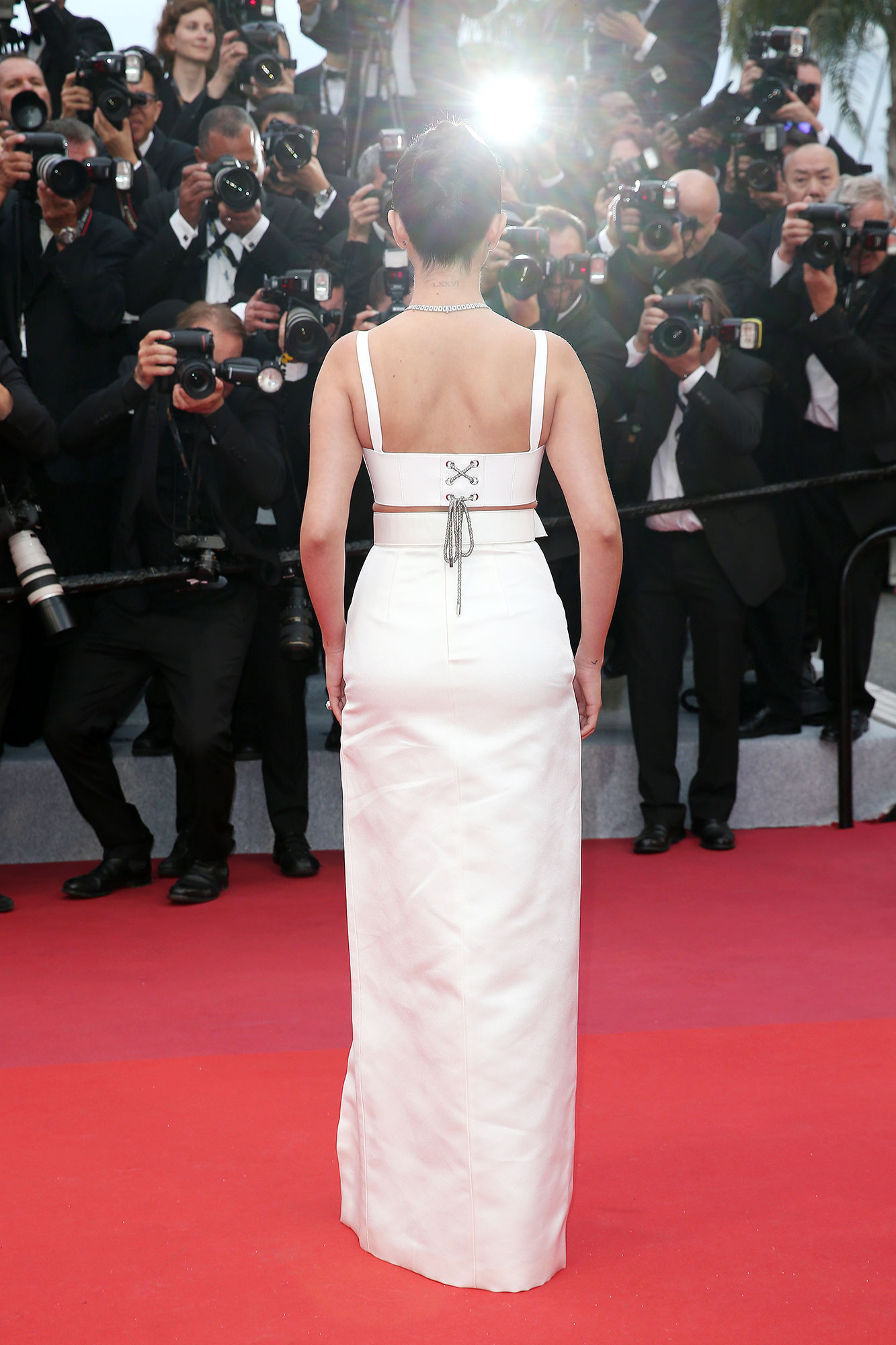 Selena Gomez Cannes - Hairstylist Marissa Marino created a clean braided bun to keep the brunette beauty's hair sleek and chic.