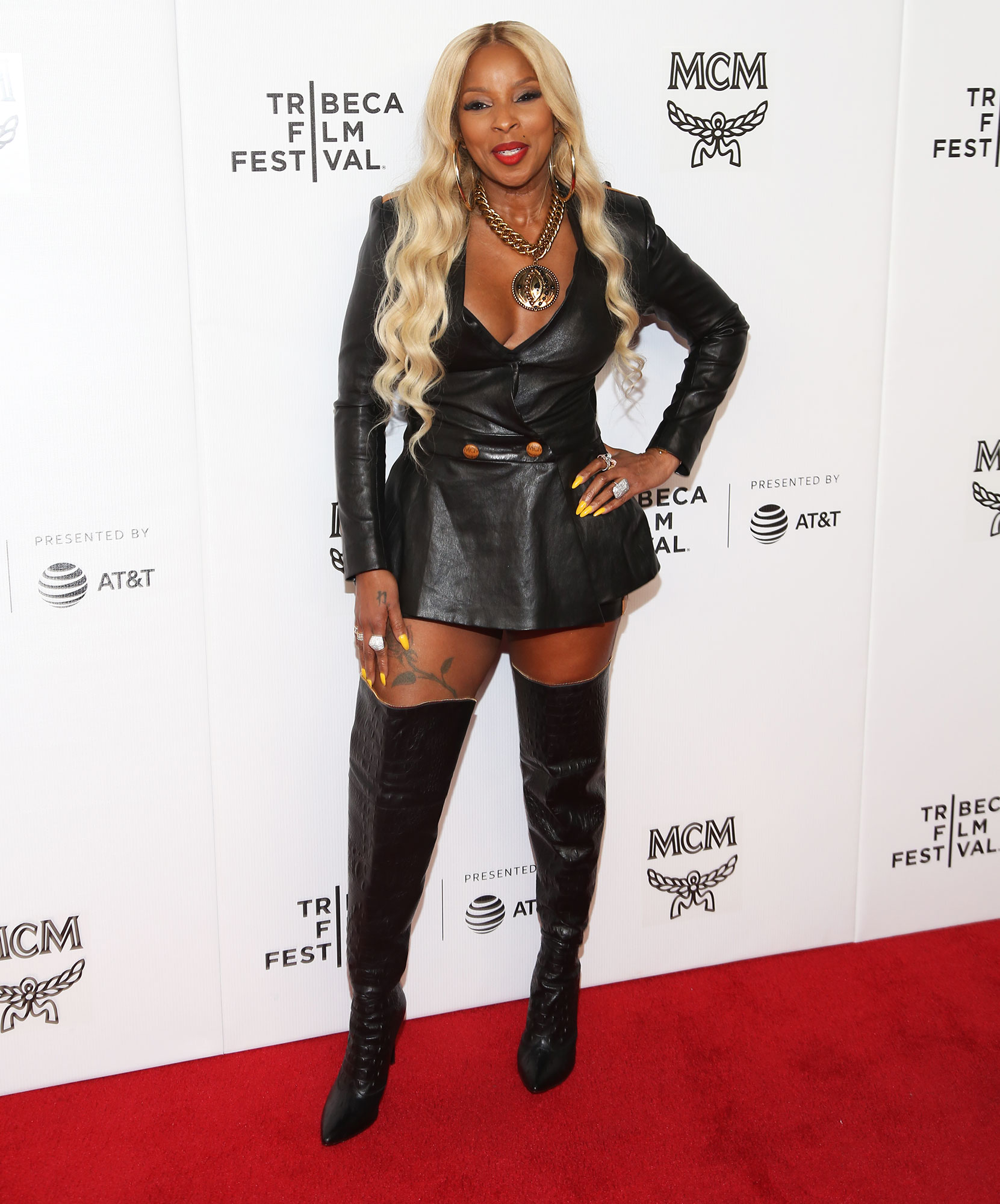 Mary J. Blige Stars up Their Style Game at Tribeca Film Festival - The music legend looked super sexy in a leather minidress with thigh-high boots and a chunky necklace at the screening of The Remix: Hip Hop X Fashion on May 2.