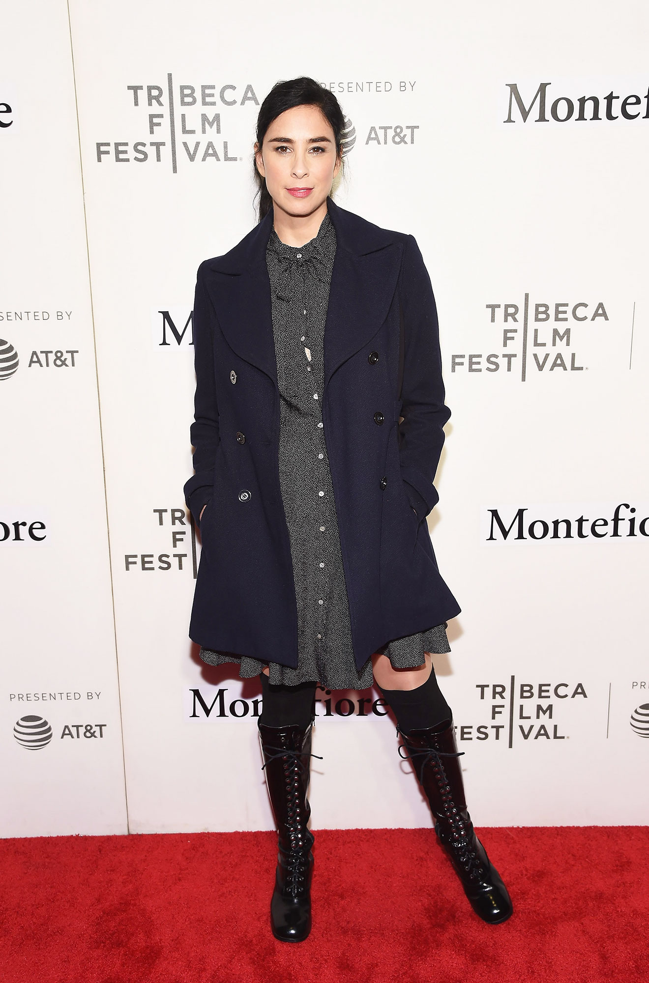 Sarah Silverman Stars up Their Style Game at Tribeca Film Festival - Keeping things cool and casual, the brunette beauty attended the Tribeca Talks panel on April 29, wearing a navy trench coat over her peasant dress and accessorizing with her classic lace-up boots.
