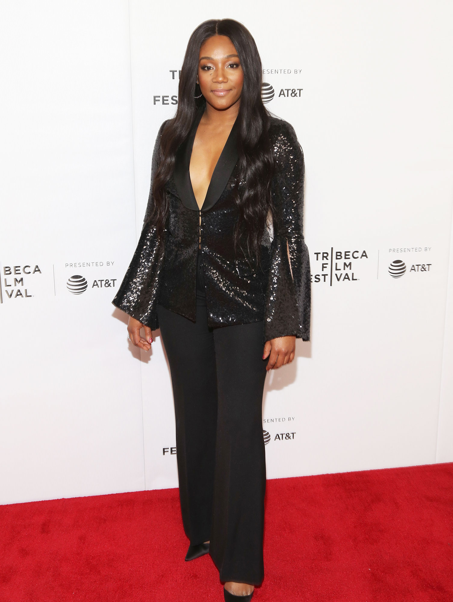 Tiffany Haddish Stars up Their Style Game at Tribeca Film Festival - Rocking the pantsuit trend, the comedian attended the Tuca & Bertie premiere on May 1 in black trousers and a sequin jacket with no shirt underneath.