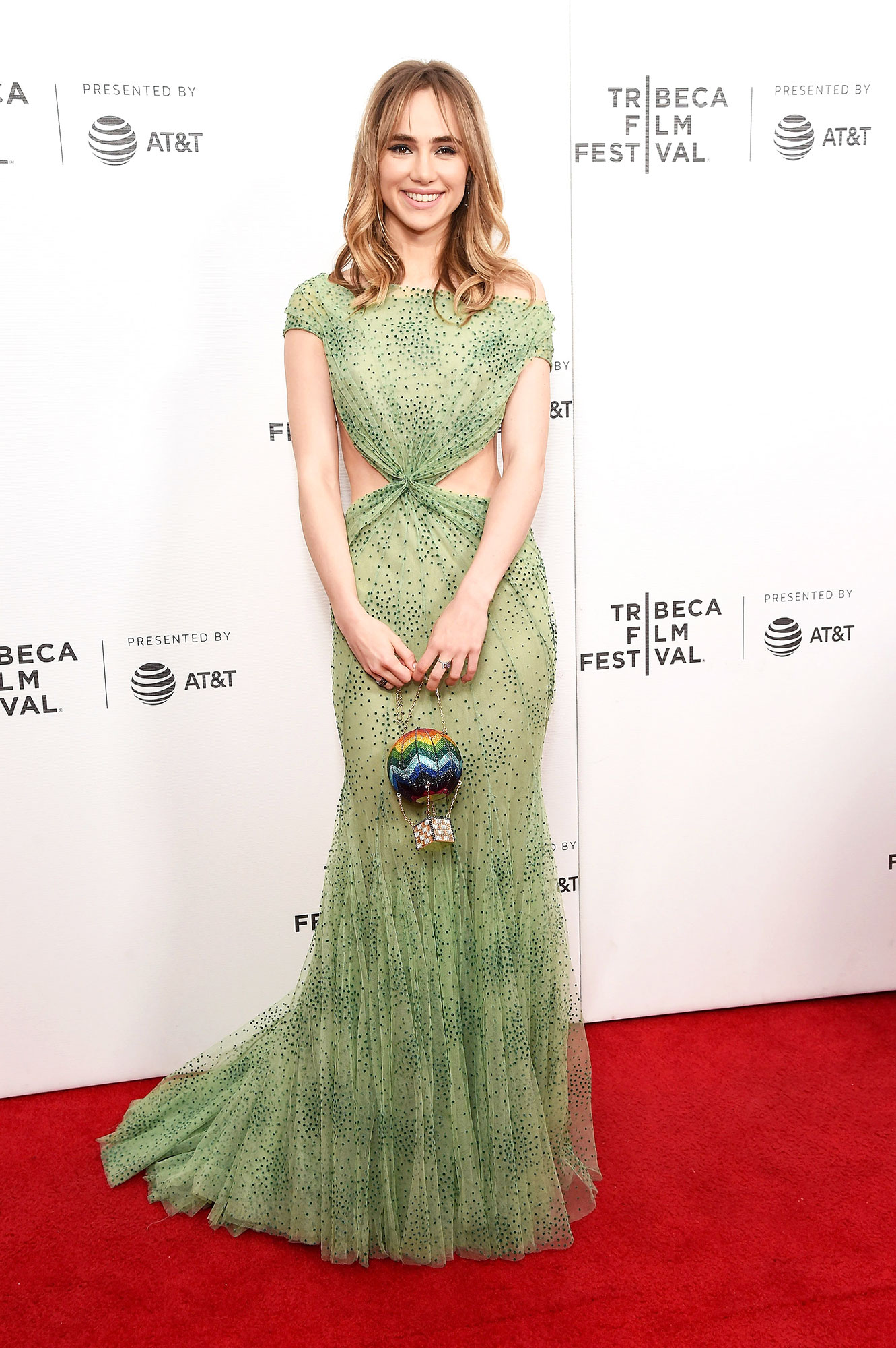 Suki Waterhouse Stars up Their Style Game at Tribeca Film Festival - Looking dreamy in green at the Charlie Says screening on May 1, the U.K. model wore a floor-length gown with stomach cutouts for added appeal.