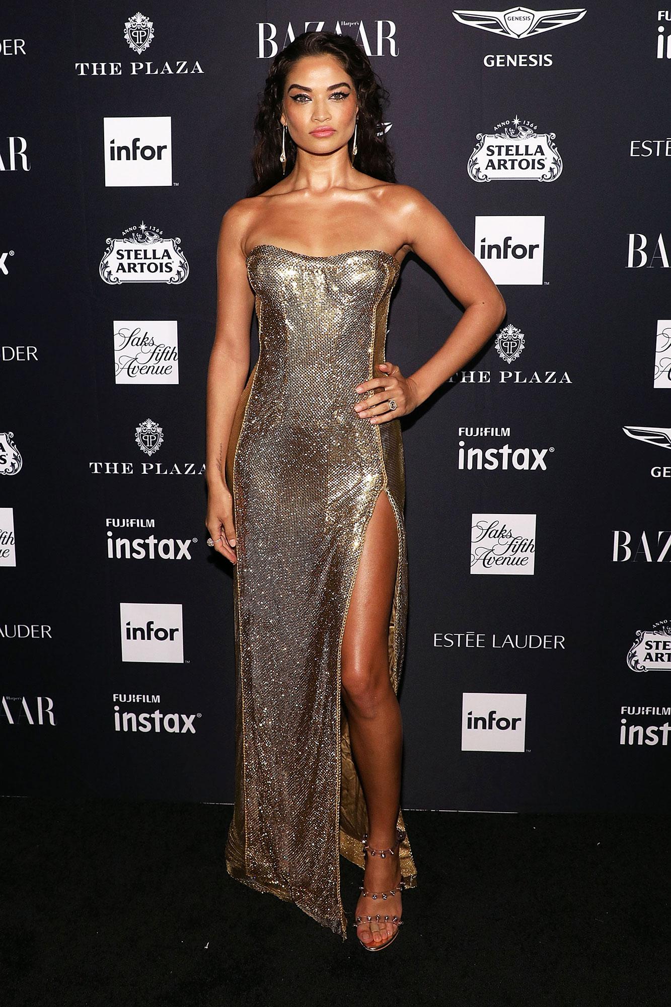 Shanina Shaik stylish gold - In a strapless Pamela Dennis on Sept. 7.