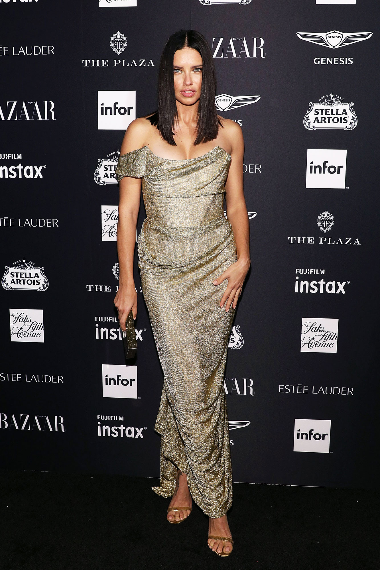Adriana Lima stylish gold - In a Vivienne Westwood Couture on Sept. 7.