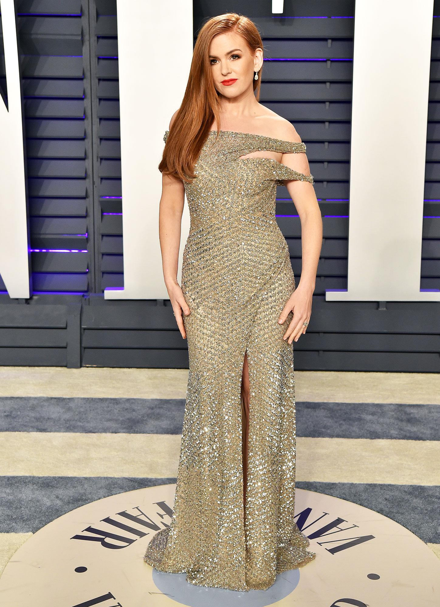 Isla Fisher stylish gold - In an off-the-shoulder Jonathan Simkhai on Feb. 24.