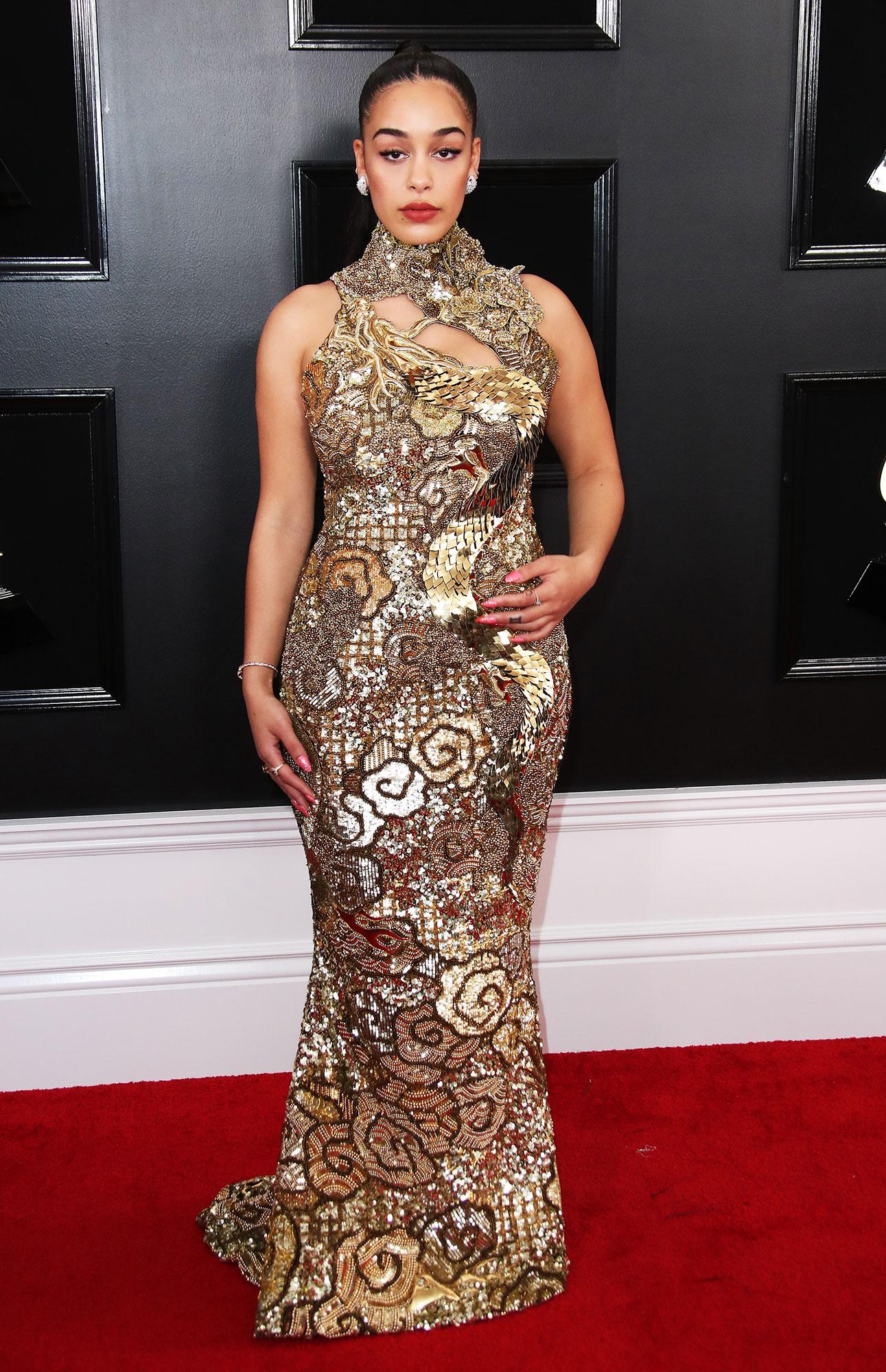 Jorja Smith stylish gold - In a custom sequin Balmain on Feb. 10.