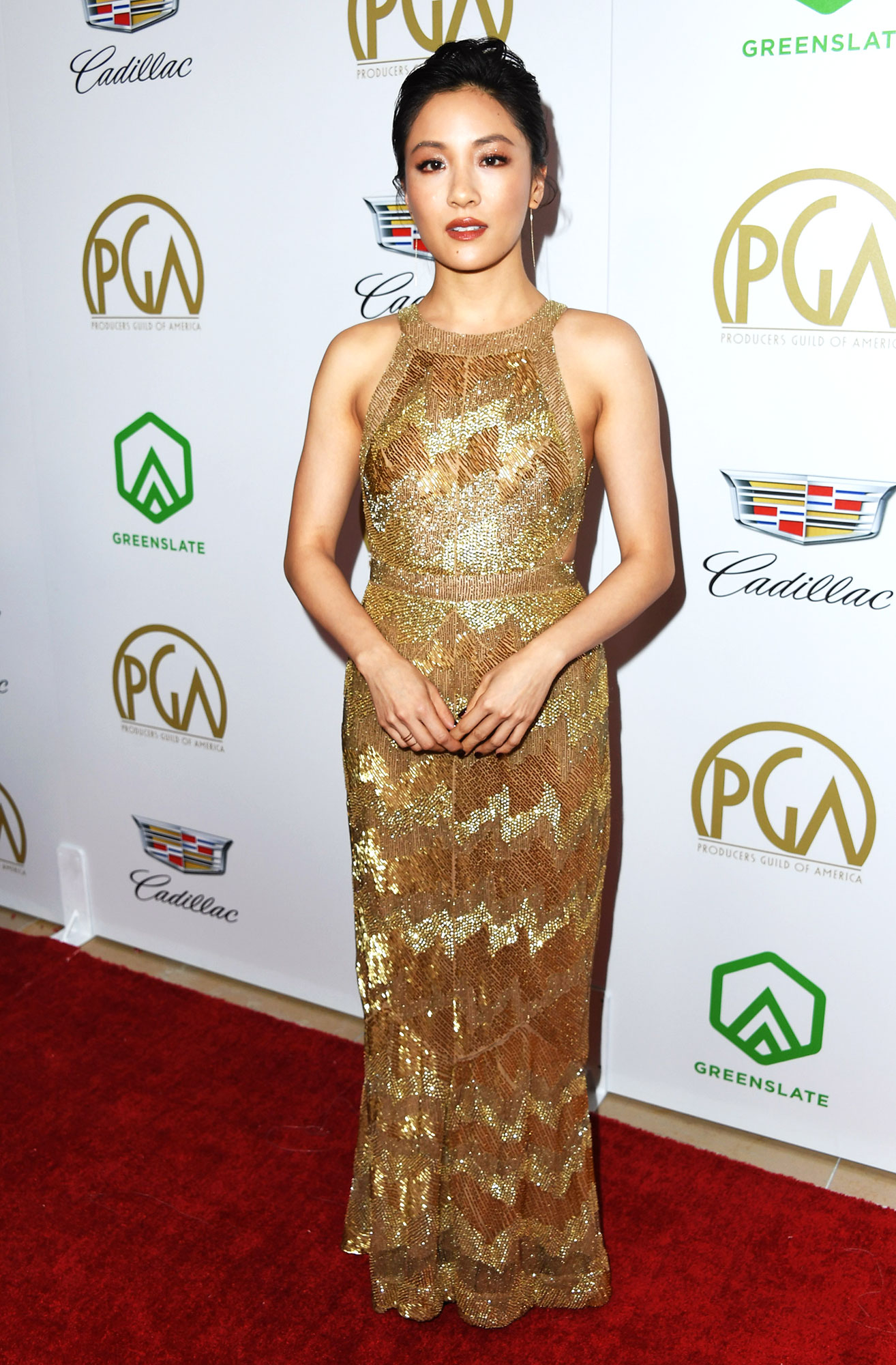 Constance Wu stylish gold - In an embroidered J. Mendel on Jan. 19.