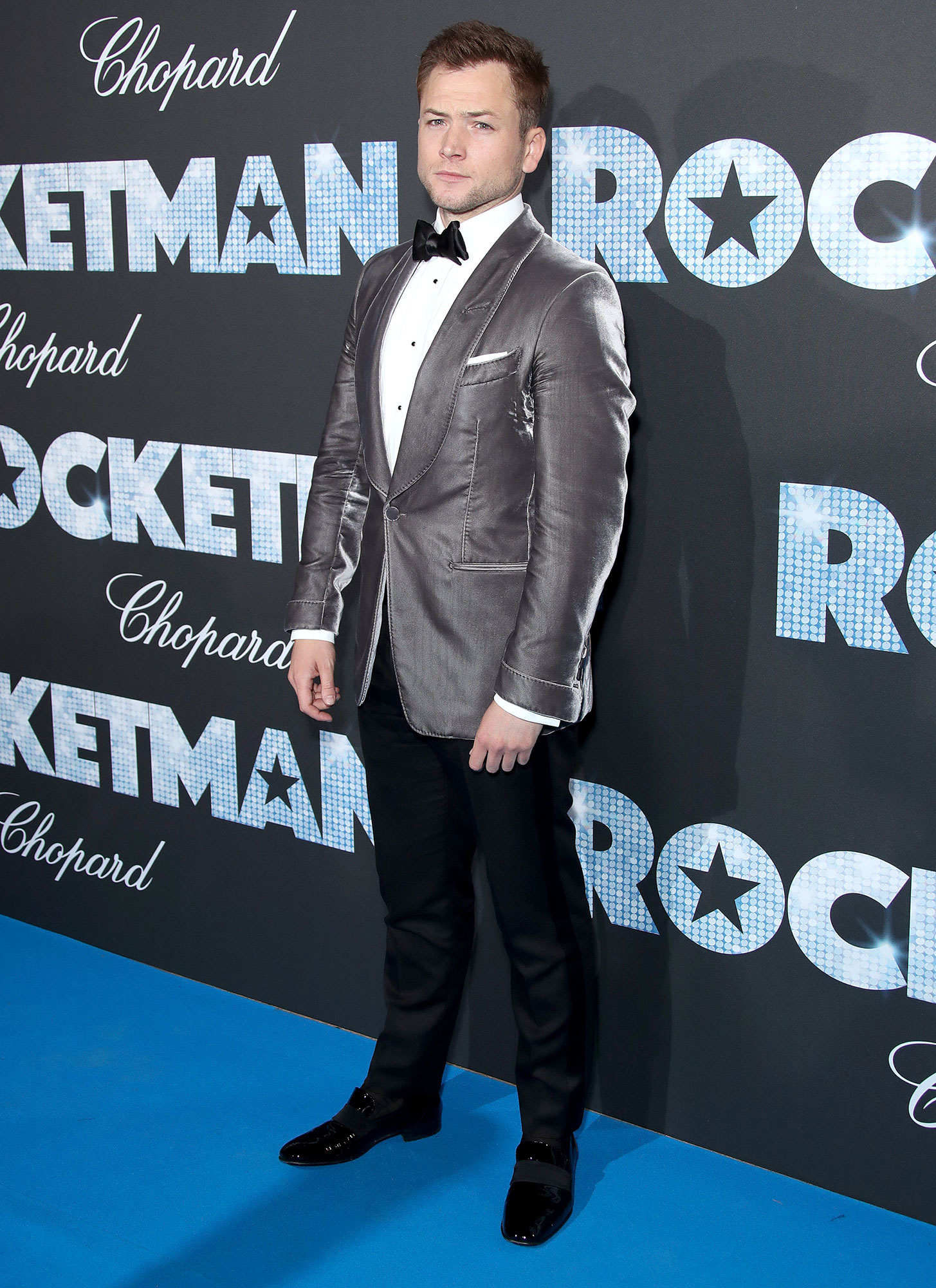 Taron Egerton Cannes Film Festival 2019 Most Stylish Guys Red Carpet - Paying homage to Elton John, perhaps? The Rocketman star shined on the blue carpet in a silver jacket on Thursday, May 16.