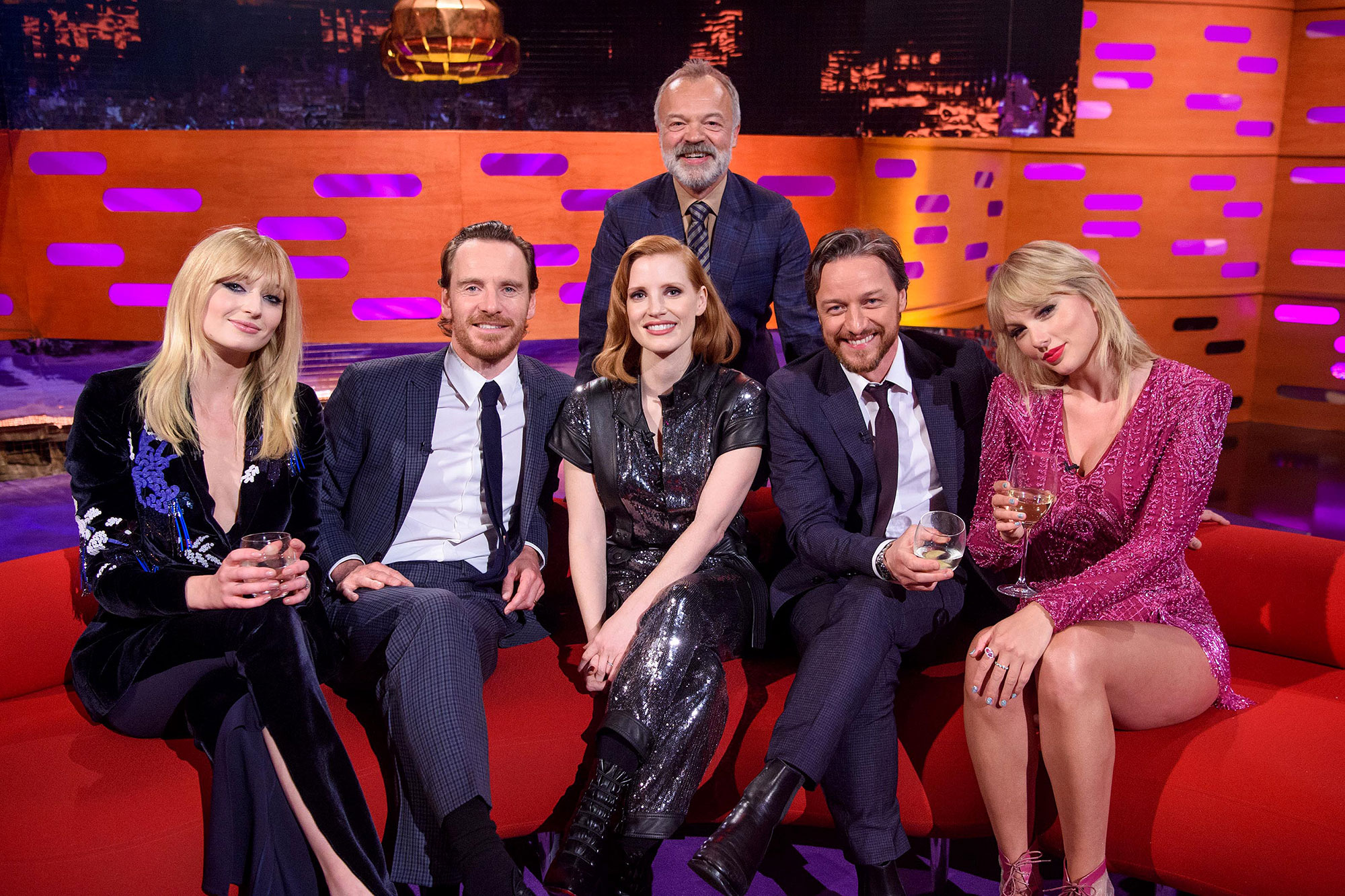 Taylor Swift and Sophie Turner Graham Norton Show - Swift and Turner posed with sweet smiles as they sat on opposite ends of the couch.