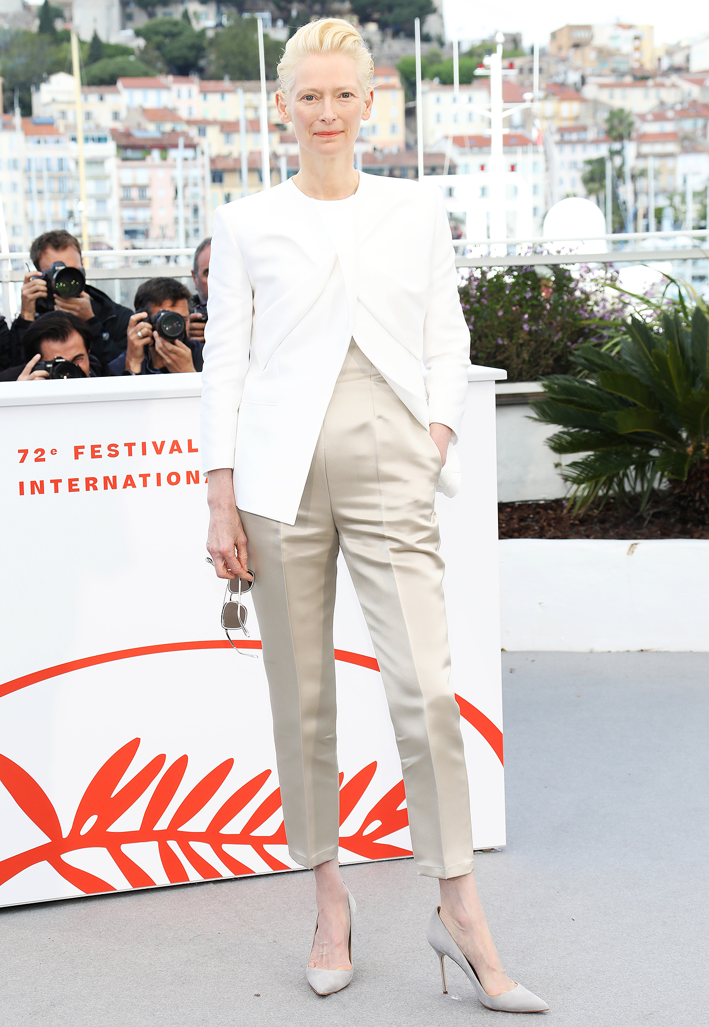 Tilda-Swinton - At the Dead Don't Die photo-call on Wednesday, May 15, the actress paired a white Haider Ackermann blazer with khaki pants and Manolo Blahnik pumps.