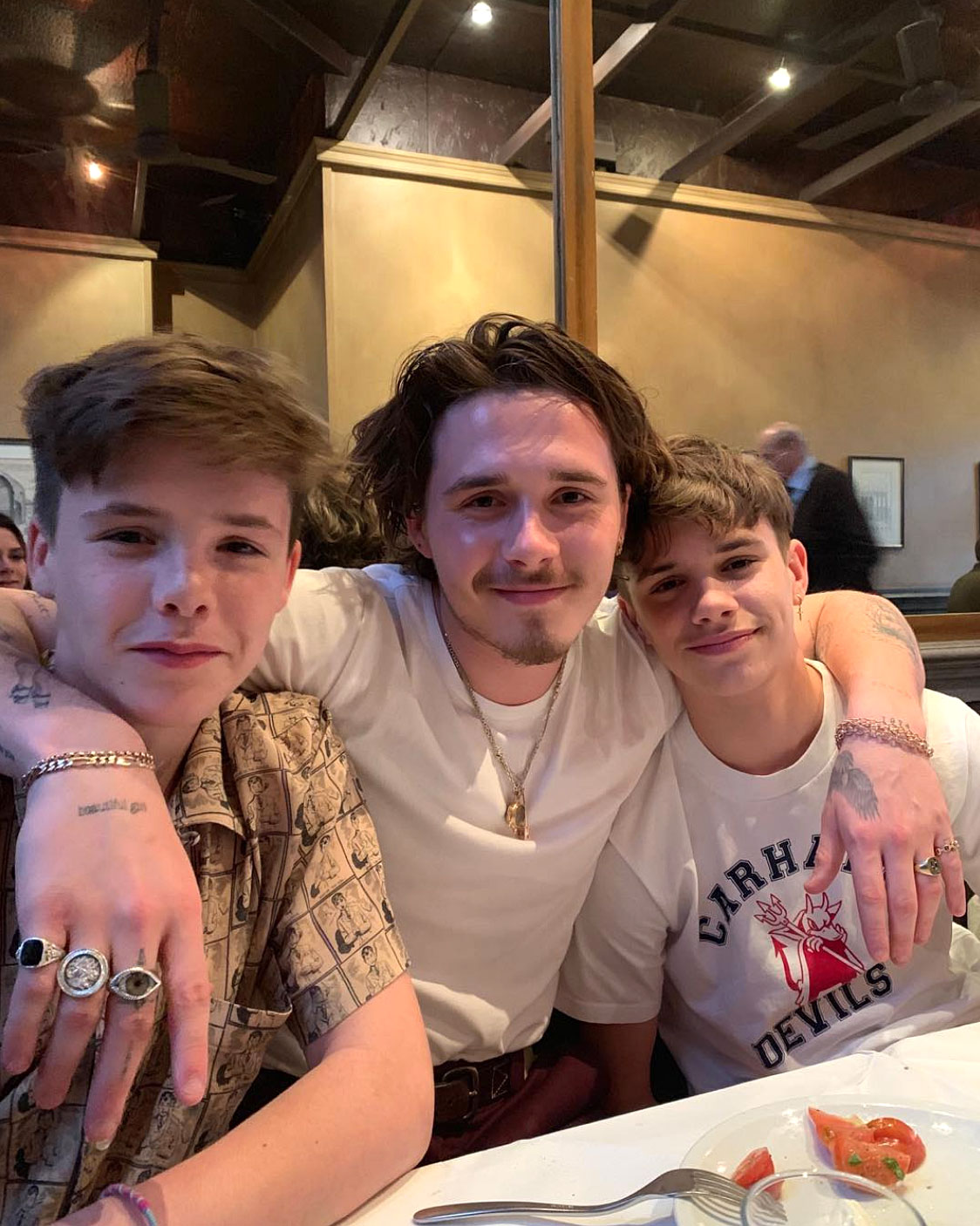 David Beckham Birthday Party - Brooklyn was the perfect big bro and posed with his arm around his two younger siblings.