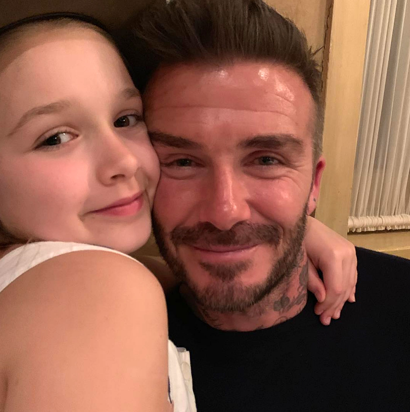 David Beckham Birthday Party - Harper snuggled in close for a snap with her father.