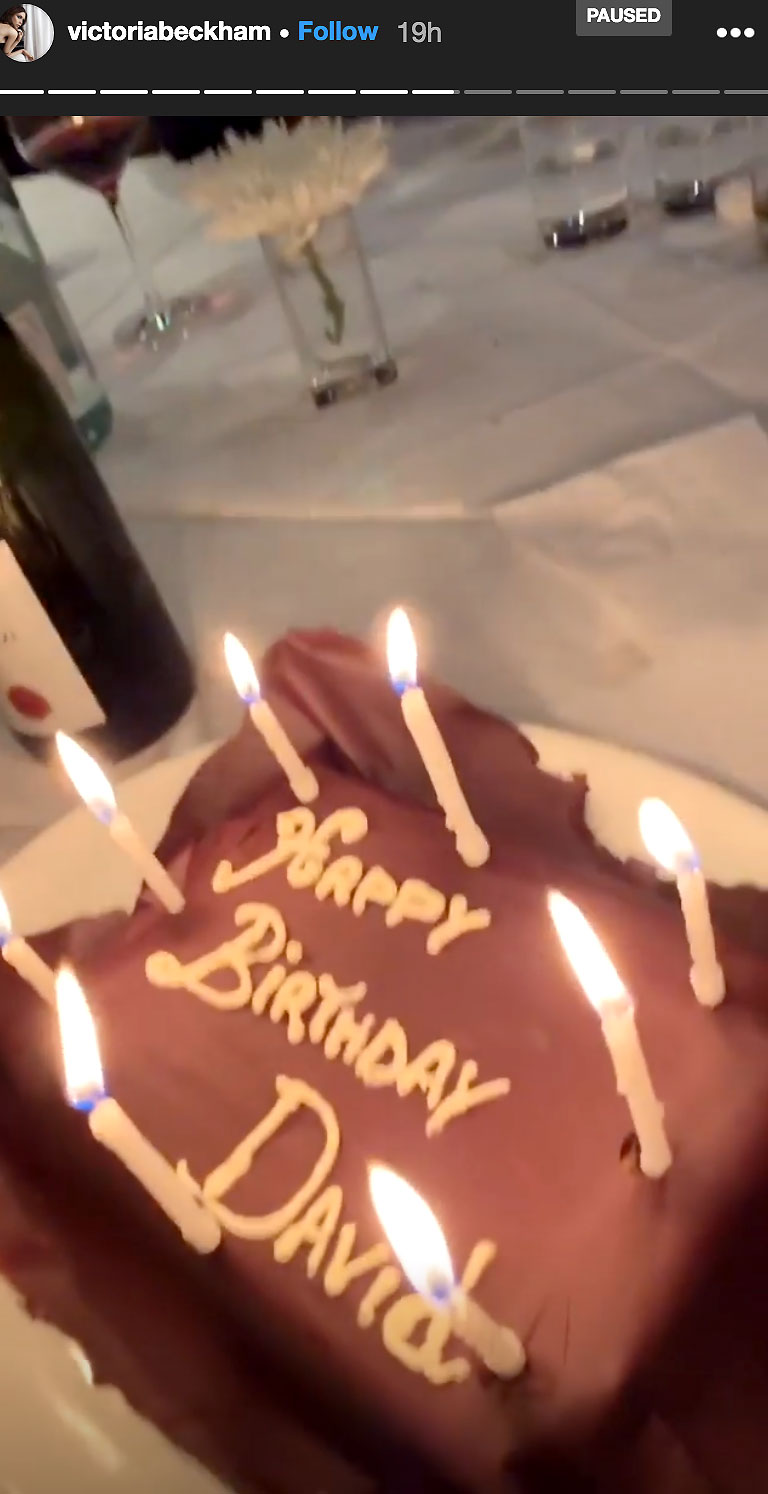 David Beckham Birthday Party - David's chocolate cake featured eight pink candles.