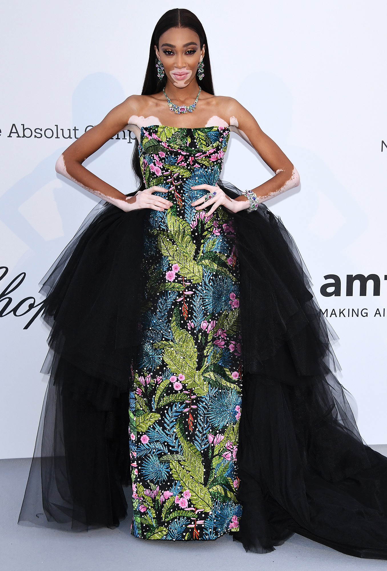 Winnie-Harlow - A black tulle skirt brought the drama out of the model's tropical-inspired Richard Quinn gown at the amfAR Cannes Gala on Thursday, May 23.