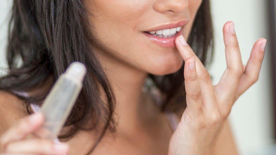 Woman Apply Lip Serum