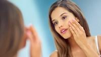 Woman Applying Skincare