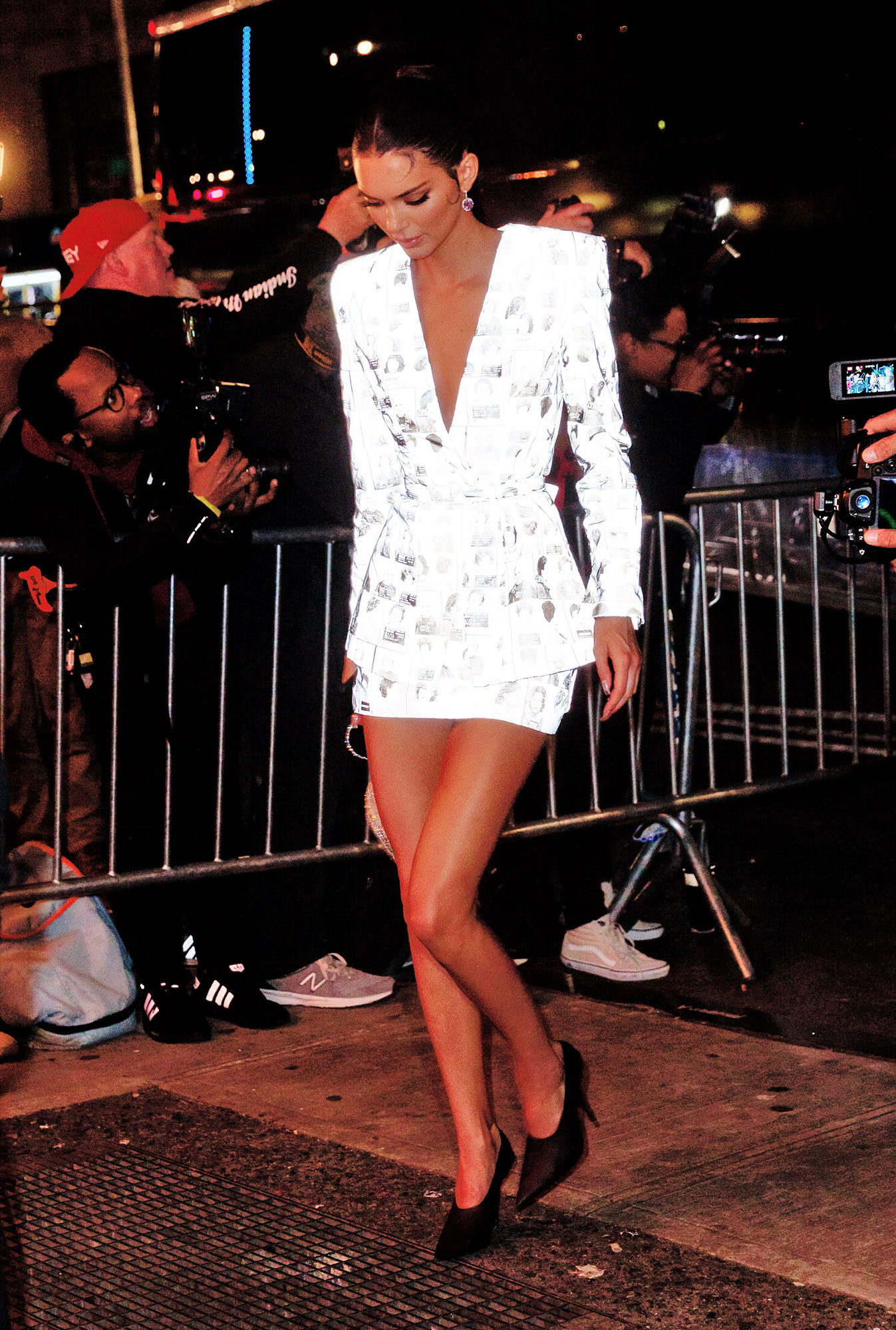 Kendall Jenner after party met gala 2019 - The model showed off her long limbs in a white miniskirt and jacket duo sans shirt underneath.