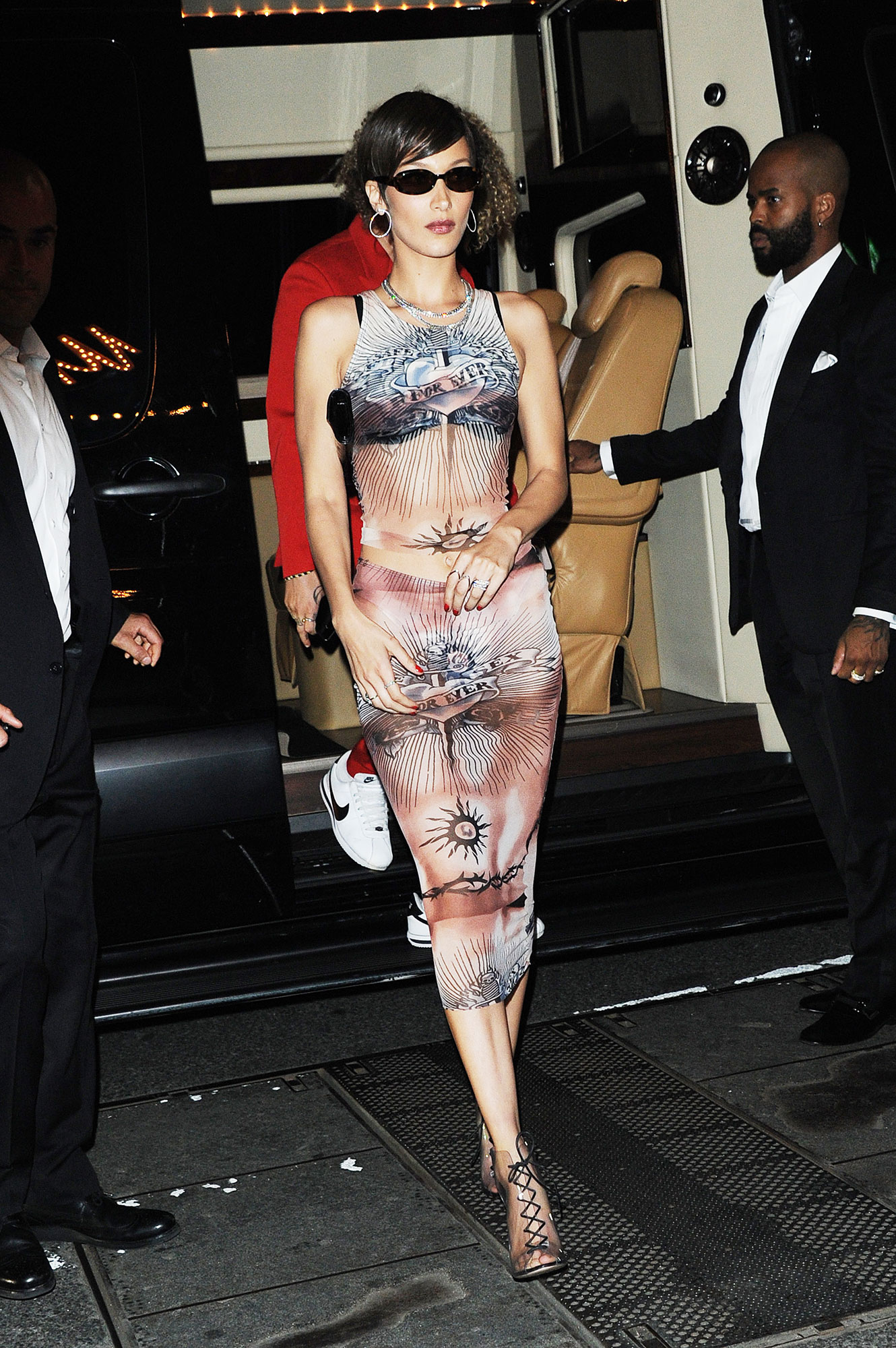 Bella Hadid after party met gala 2019 - The brunette beauty hit up Up & Down in a form-fitting print dress and her signature tiny shades.