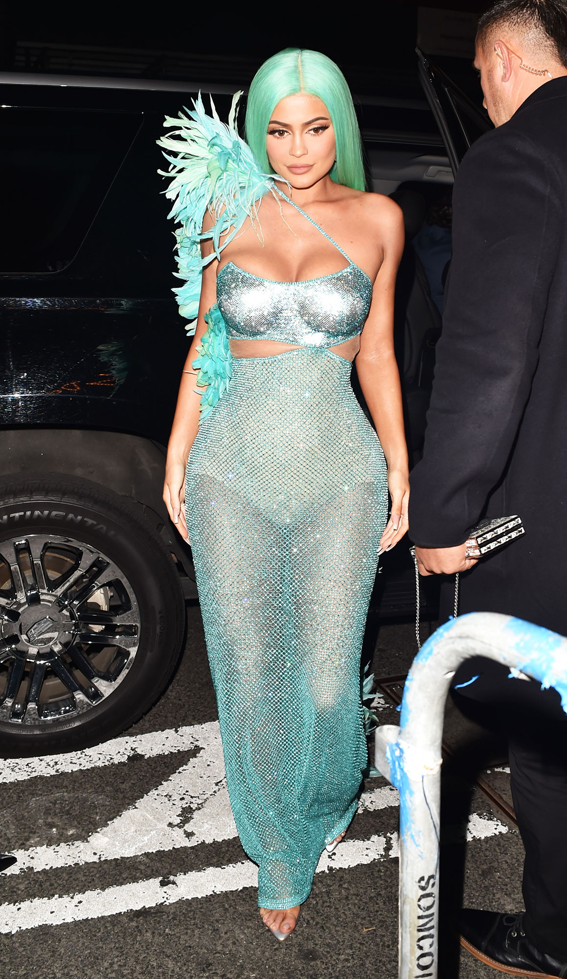Kylie Jenner after party met gala 2019 - Looking like a real life mermaid, the Kylie Cosmetics founder wore an aqua floor-length dress covered in sequins and embellished with feathers on one sleeve. She matched her new butt-grazing wig to the dress for a major mermaid-like effect.
