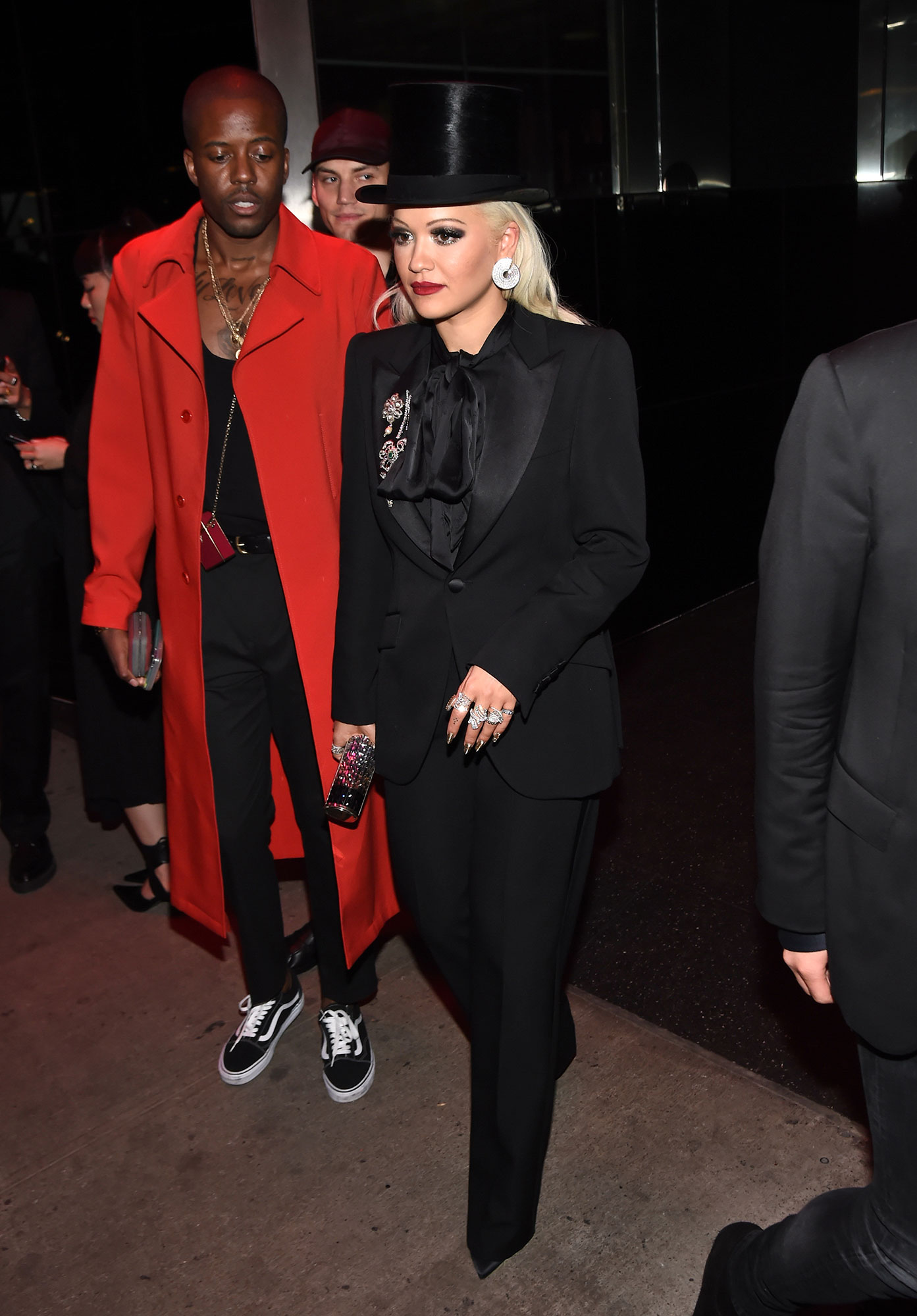 """Vas J Morgan and Rita Ora after party met gala 2019 - Cool and dapper in a full black tux, the """"Girls"""" singer amped up her look with a top hat and puffy bow."""
