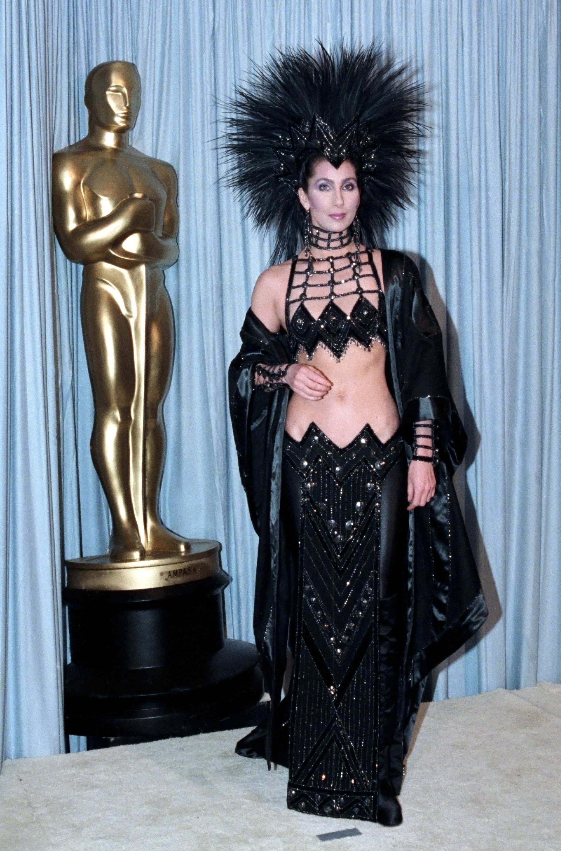 Cher Through The Years - Cher infamously clashed with Mask director Peter Bogdanovich on set, so she attended the Oscars in a black tarantula-like dress in a reported attempt to prove a point.