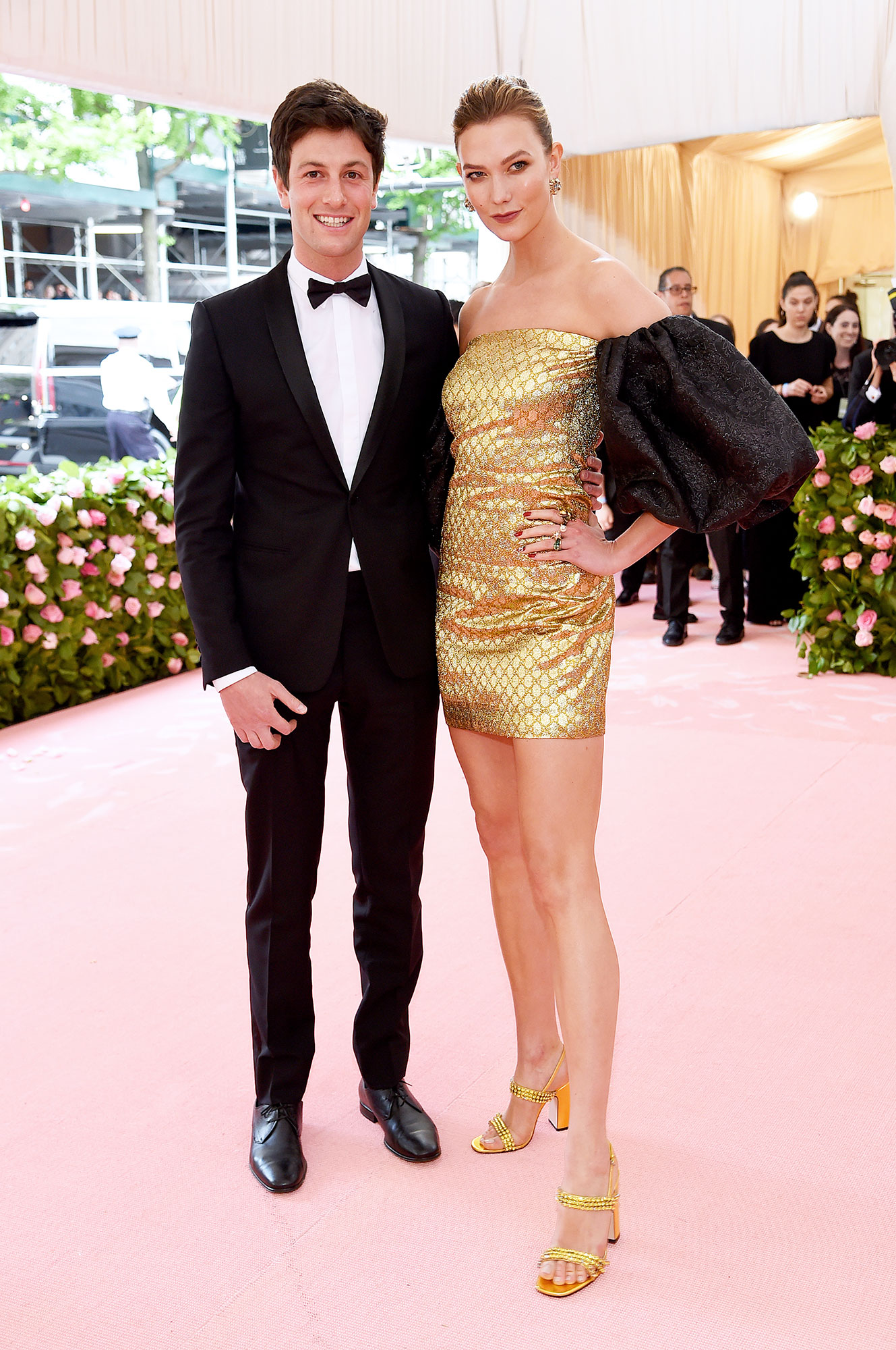Joshua Kushner and Karlie Kloss met gala 2019 couples - The Project Runway host showed some leg in a Gucci x Dapper Dan gold and black mini, which coordinated with her husband's black tux.