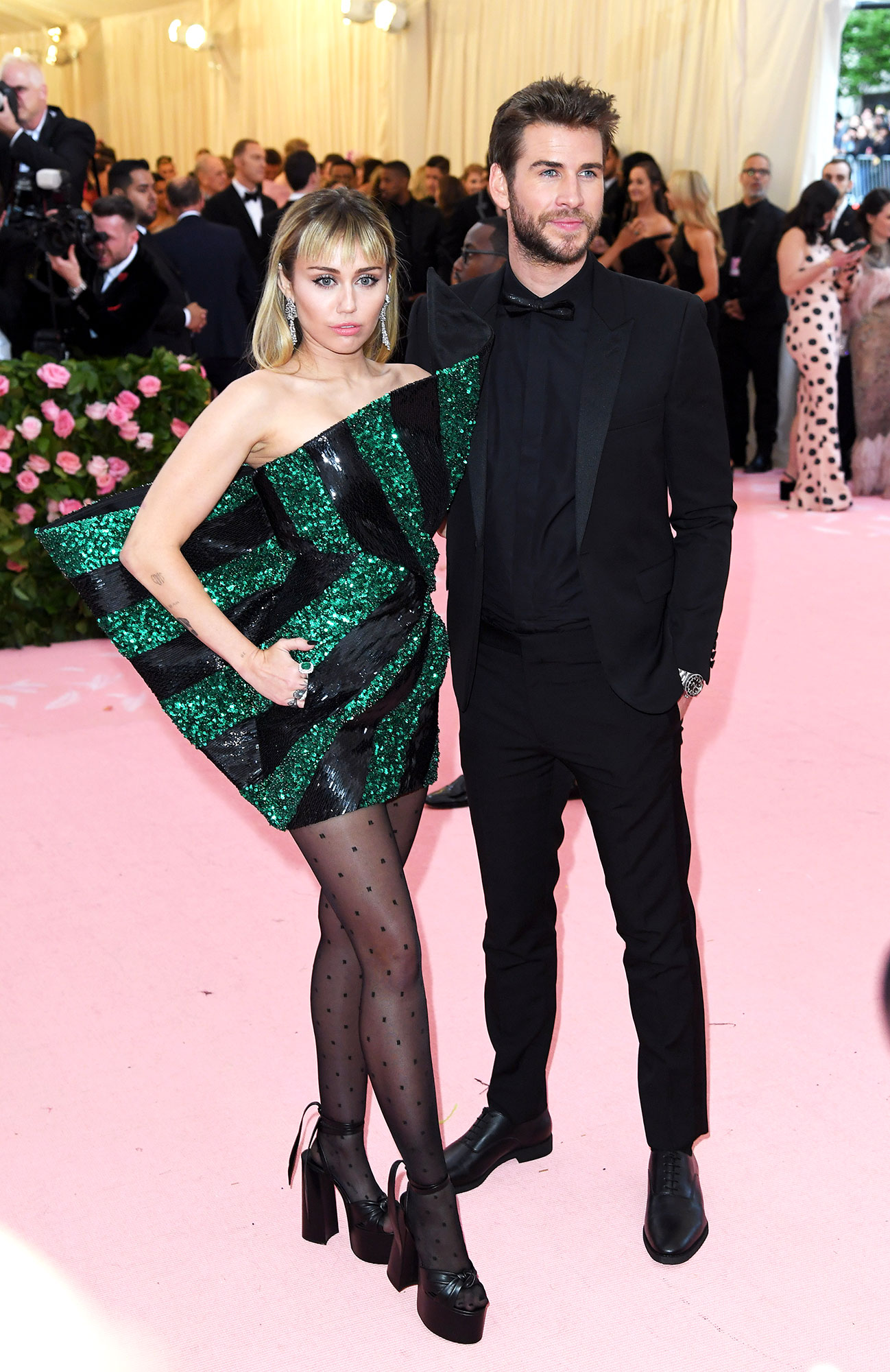 Miley Cyrus and Liam Hemsworth met gala 2019 couples - The husband and wife duo opted for complementary Saint Laurent looks.