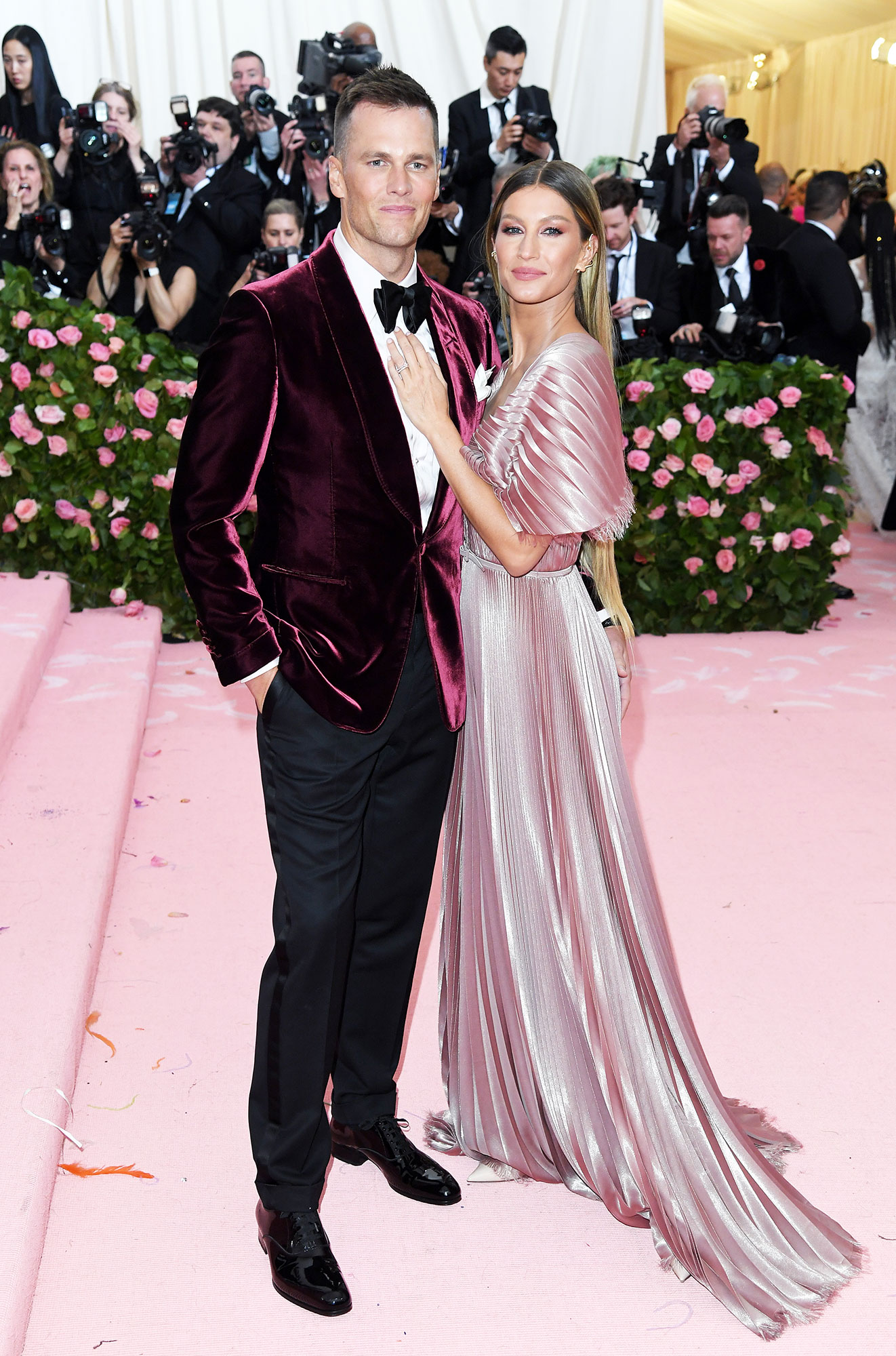 Tom Brady and Gisele Bundchen met gala 2019 couples - They may not have been on-theme, but the genetically blessed duo color coordinated in shades of pink. The supermodel stunned in pleated Dior.